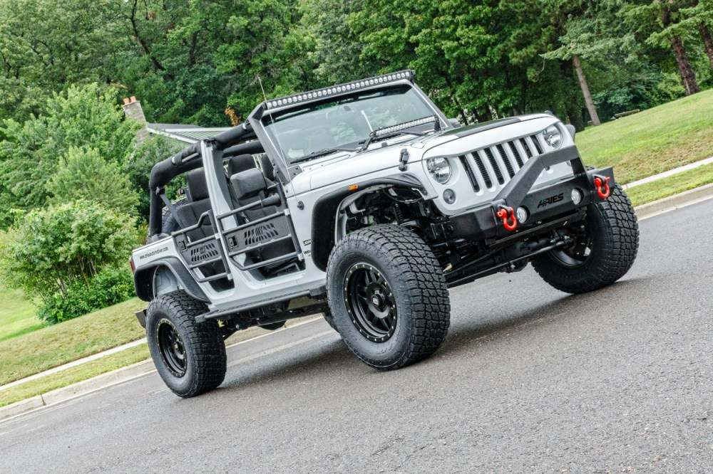 medium resolution of  white custom jeep wrangler jk with jeep doors trailcrusher bumper and fender flares