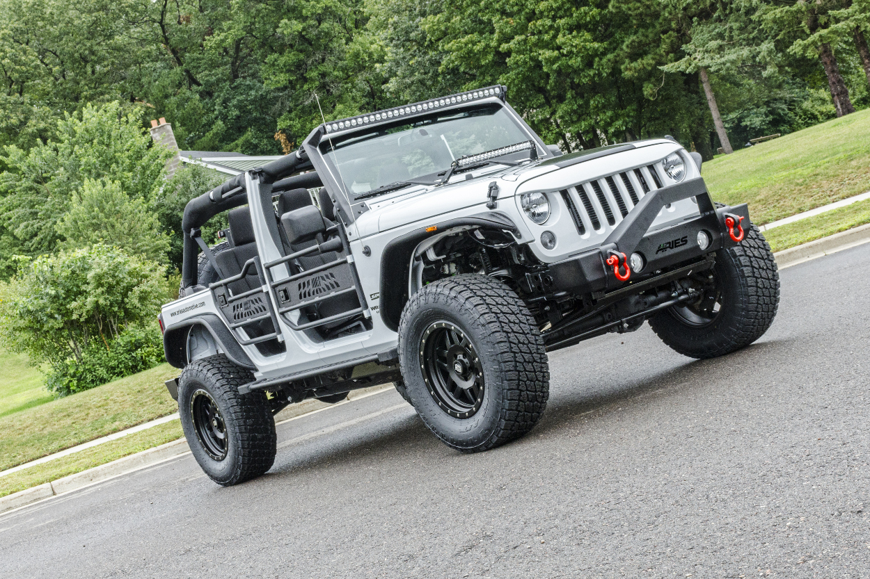 hight resolution of  white custom jeep wrangler jk with jeep doors trailcrusher bumper and fender flares