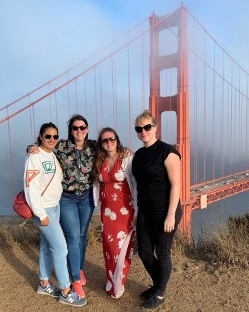 Silke, Jenny, and two colleagues in front of the Golden Gate Bridge in San Francisco, California.