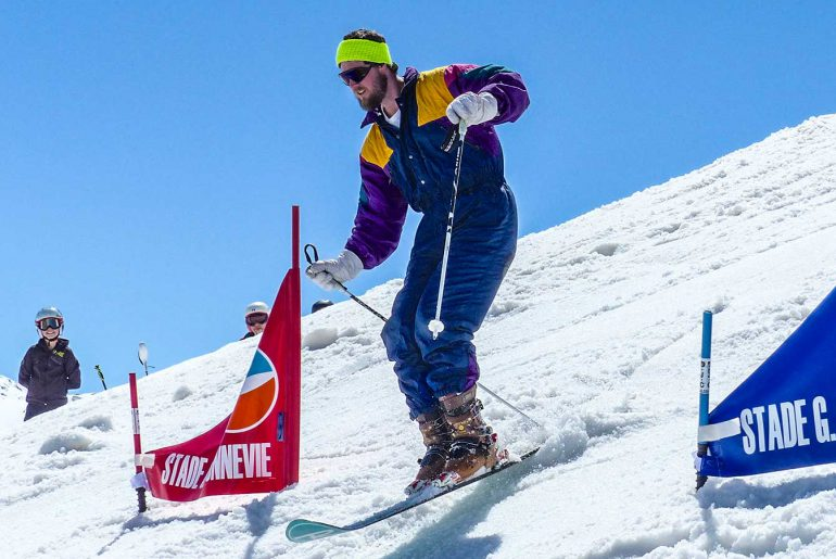 Man in retro ski clothing in monoski championship race