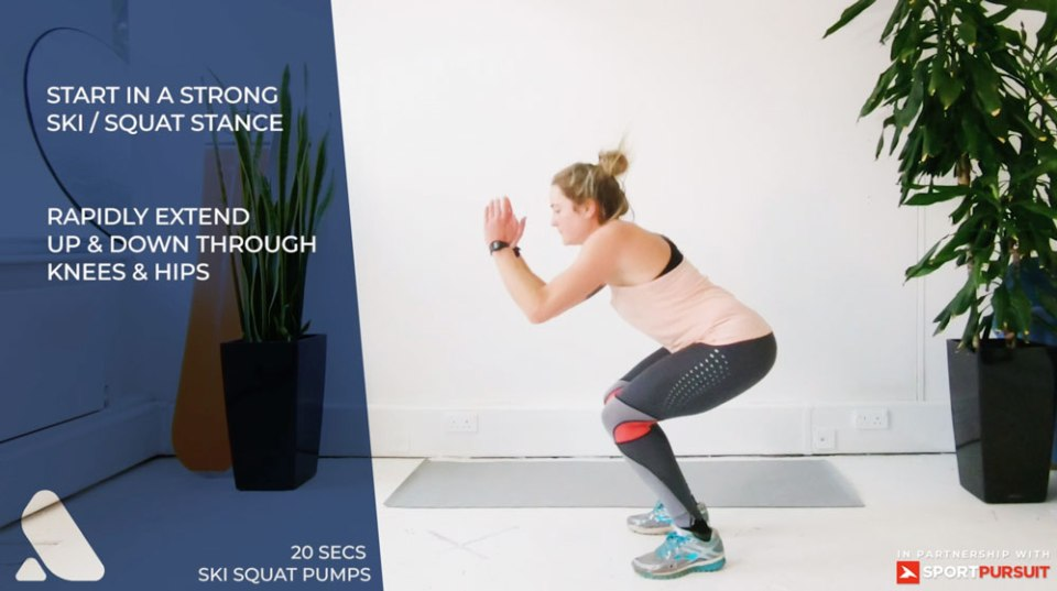 woman doing pre-ski workout for leg strength - ski squats pumps