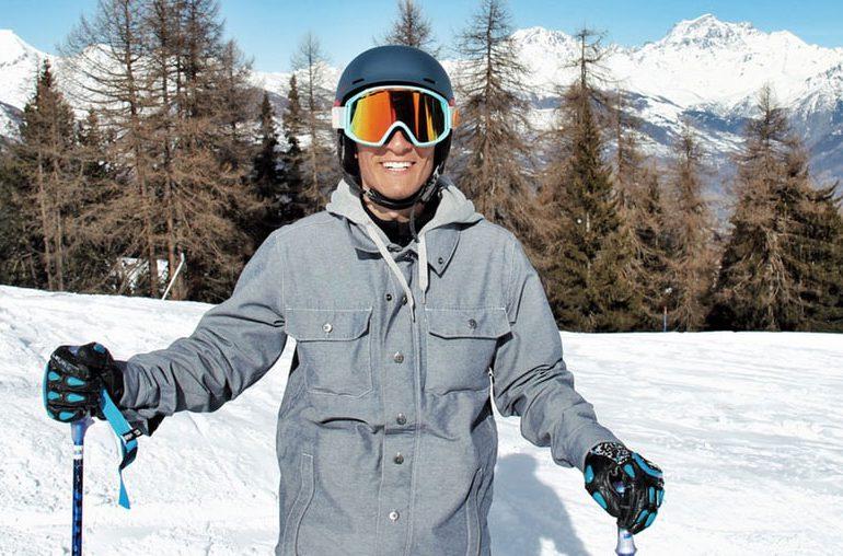 ski outerwear - smiling man wearing ski jacket