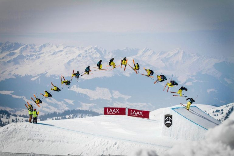 freestyle skier does huge trick on jump in Laax