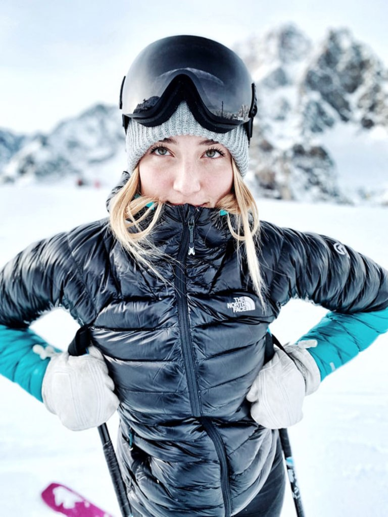 woman on mountain in ski jacket and outerwear