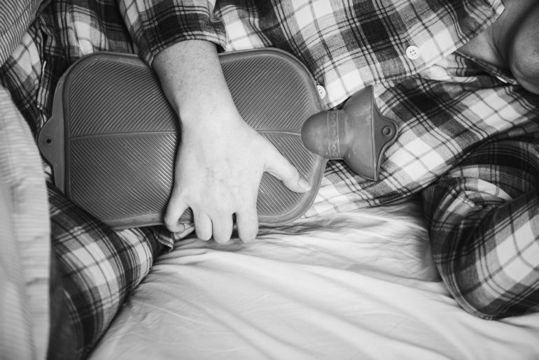 man sleeping with hot water bottle