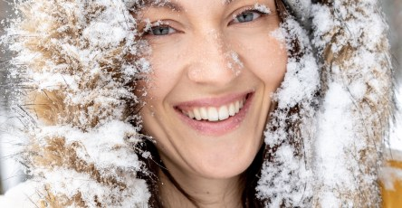 Photo of Smiling Woman Covered in Snow