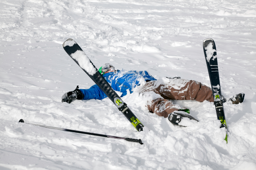 Skier on the ground covered in snow after falling