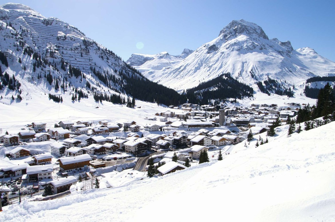 The pretty Austrian ski village of Lech am Arlberg lying between two large snow covered mountains