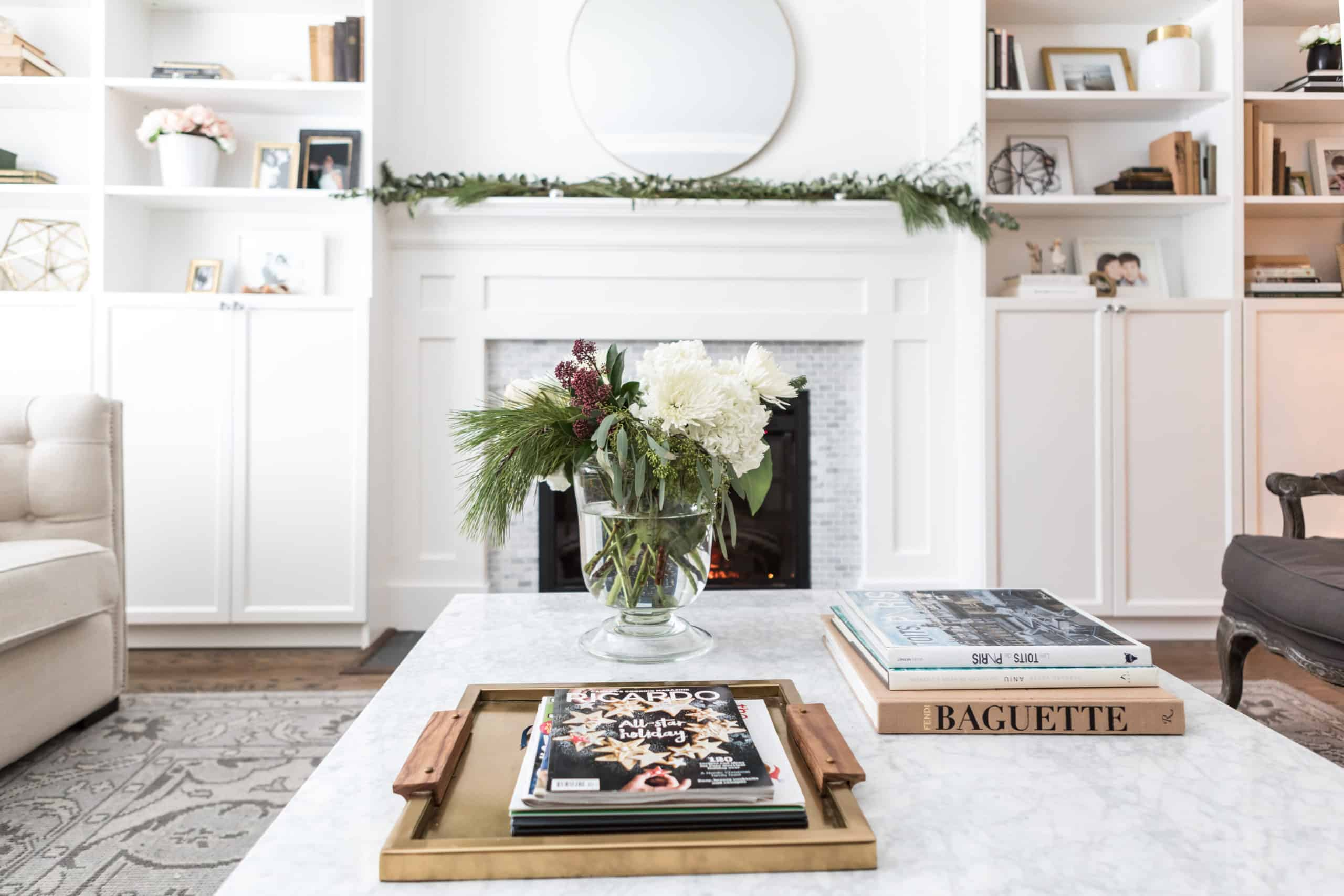 Books and flowers on a marble coffee table