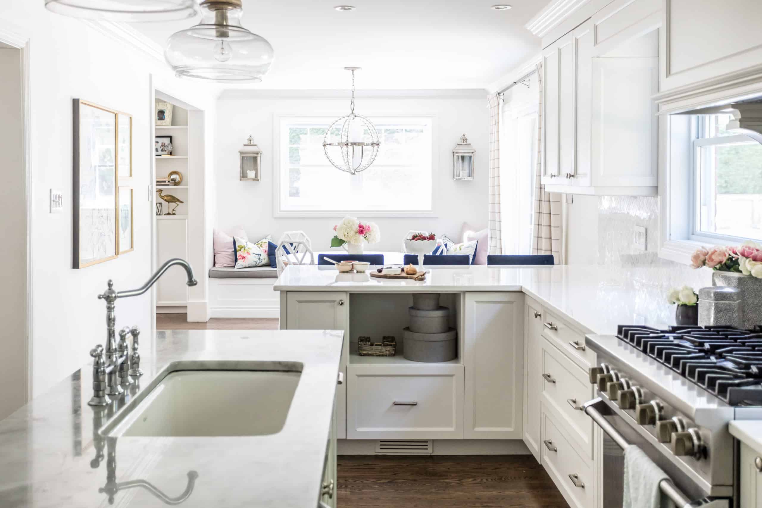 White kitchen with a dining room next to it