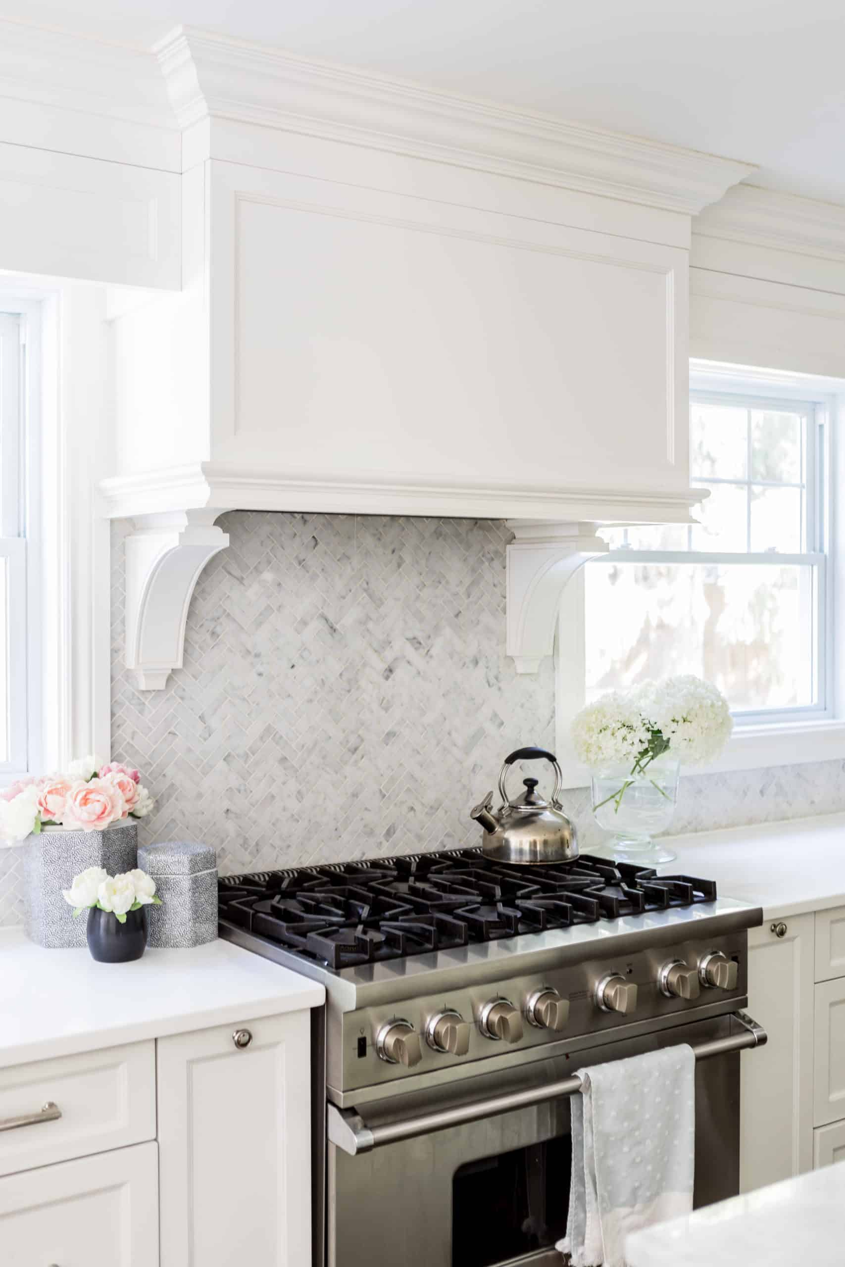 Bright white kitchen with a focus on the oven