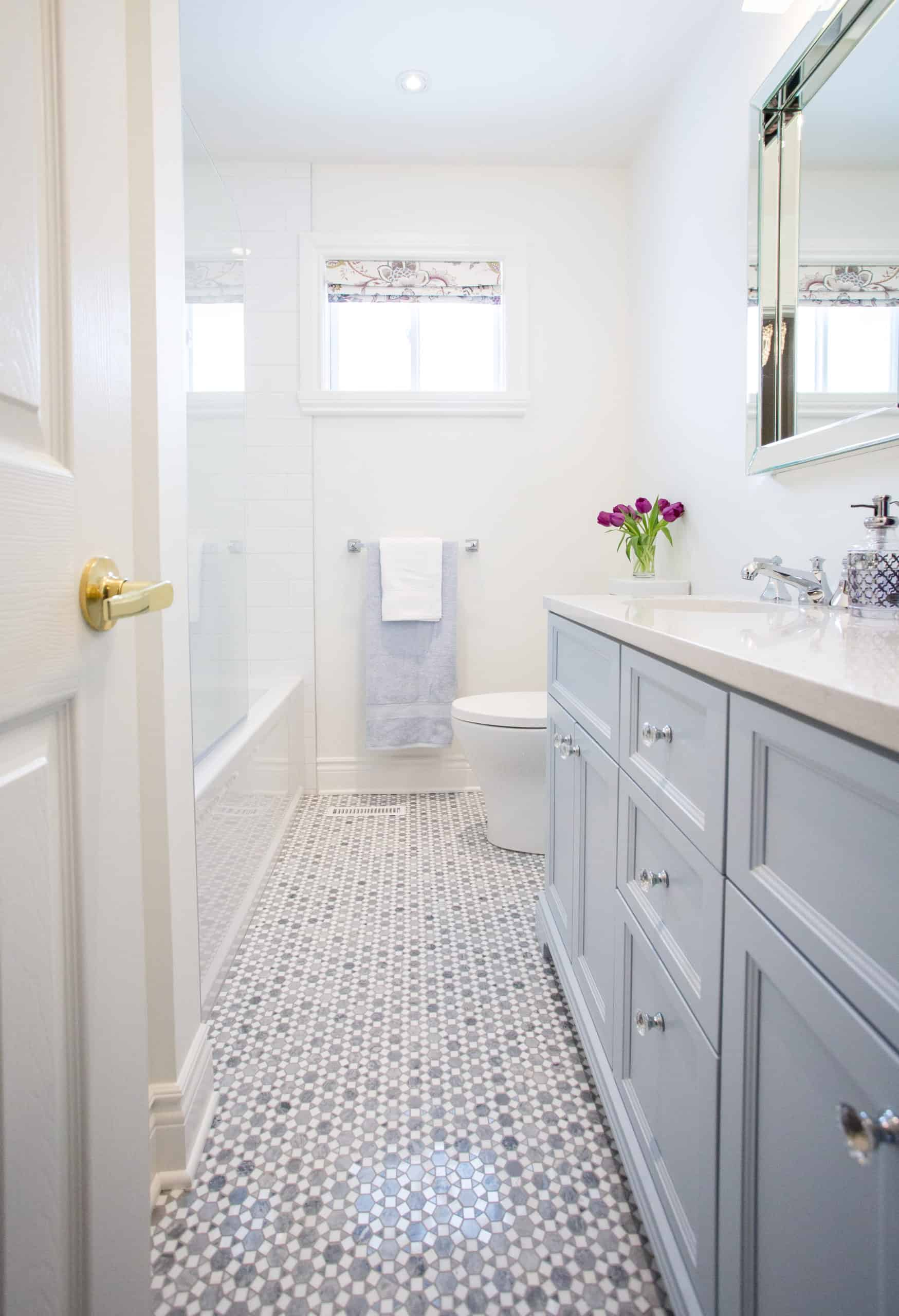 Bright white vanity with a marble countertop