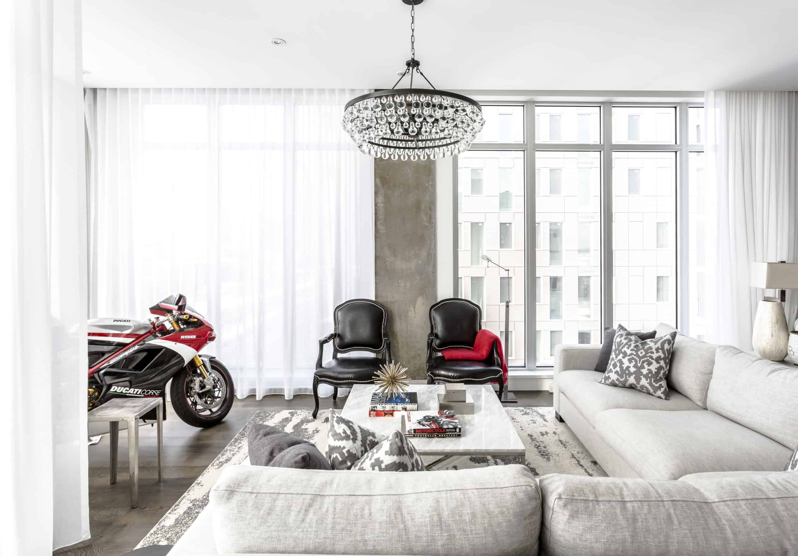 Modern living room with a motorcycle inside it
