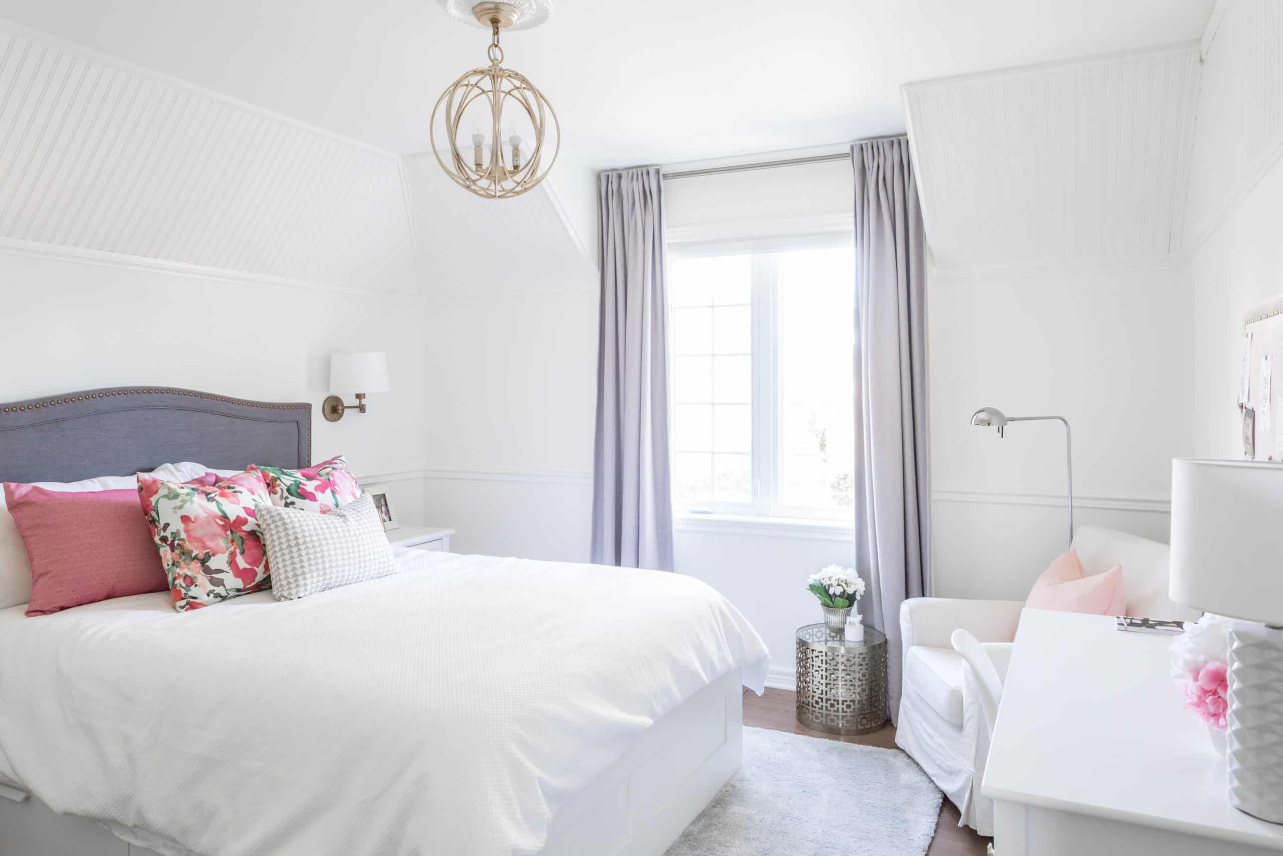Bedroom with a white, pink and purple color scheme