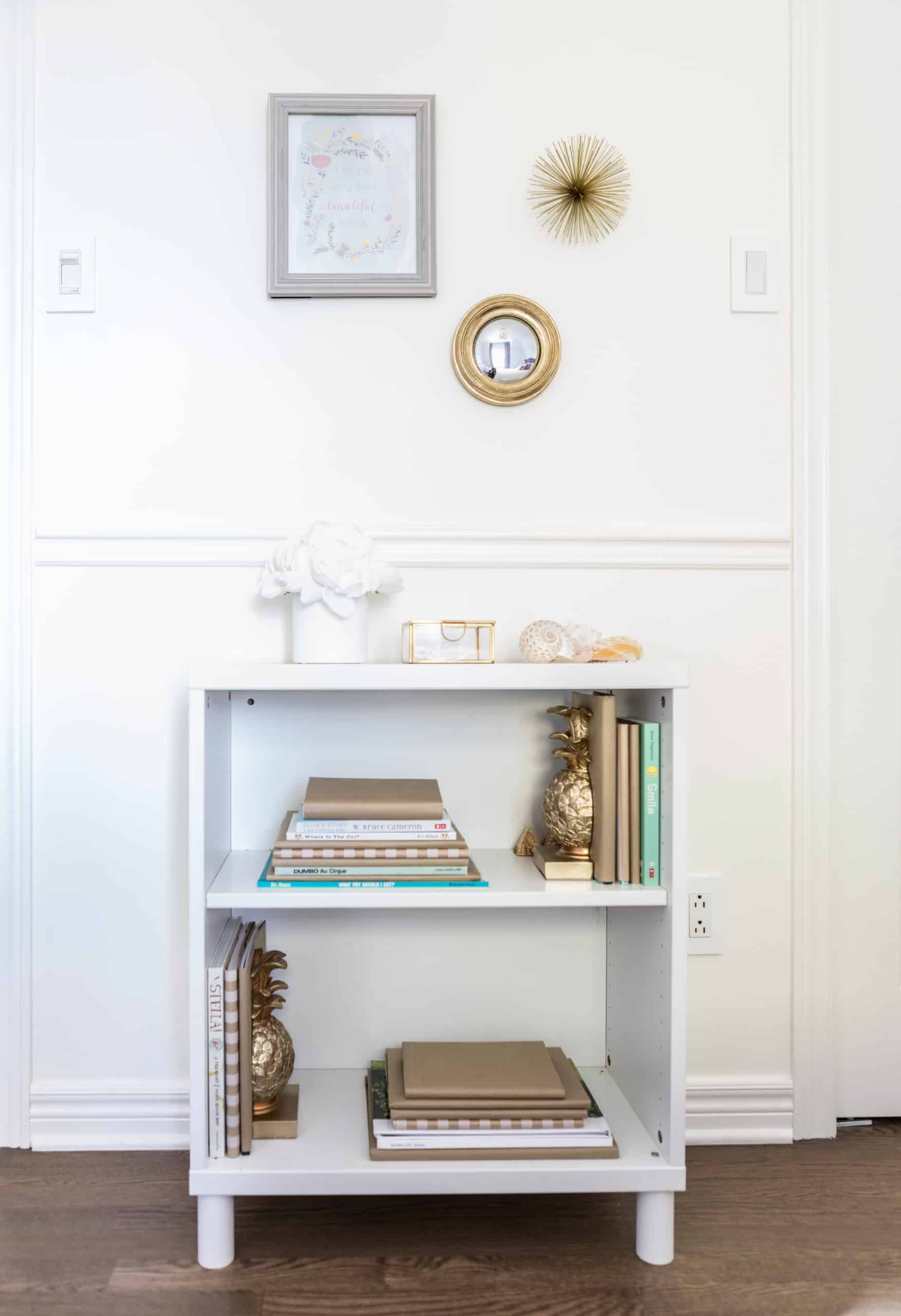 Small bookshelf with various books on it