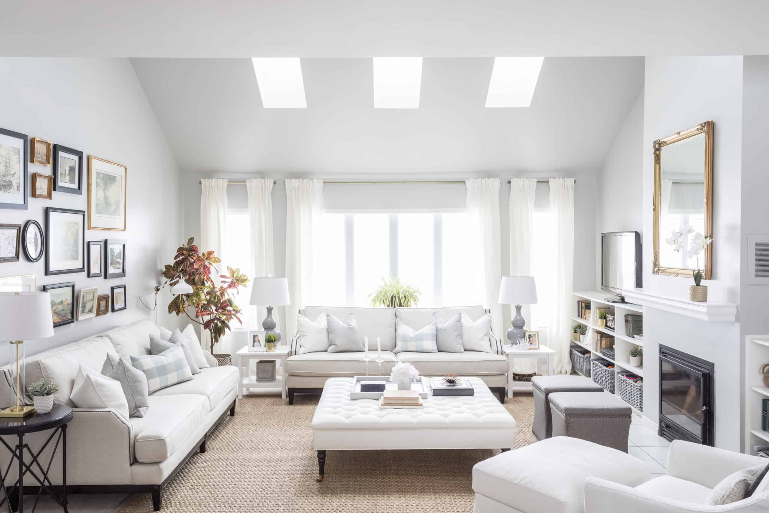 White couch against a bright window inside a large living room