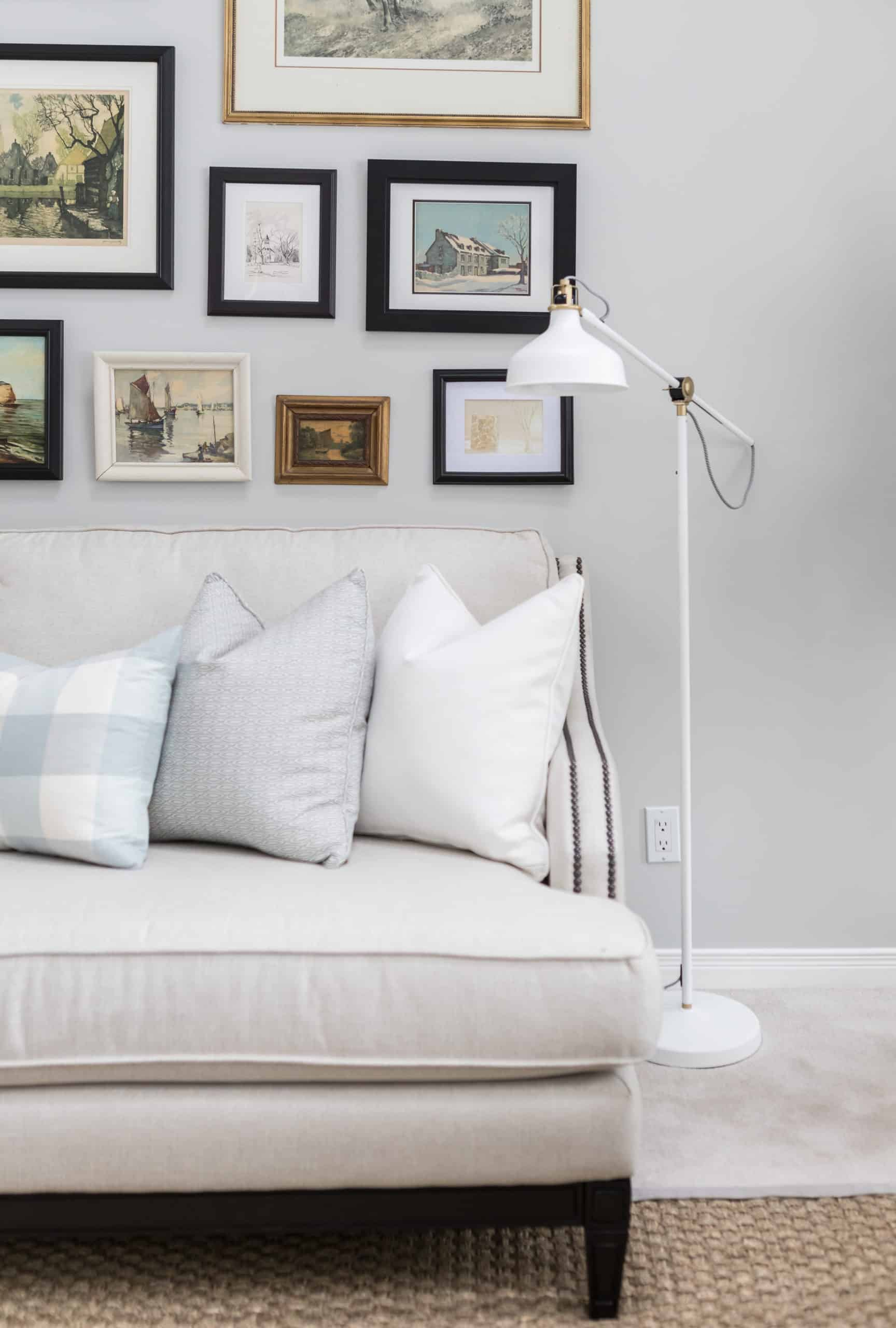 Tall work lamp next to a white couch