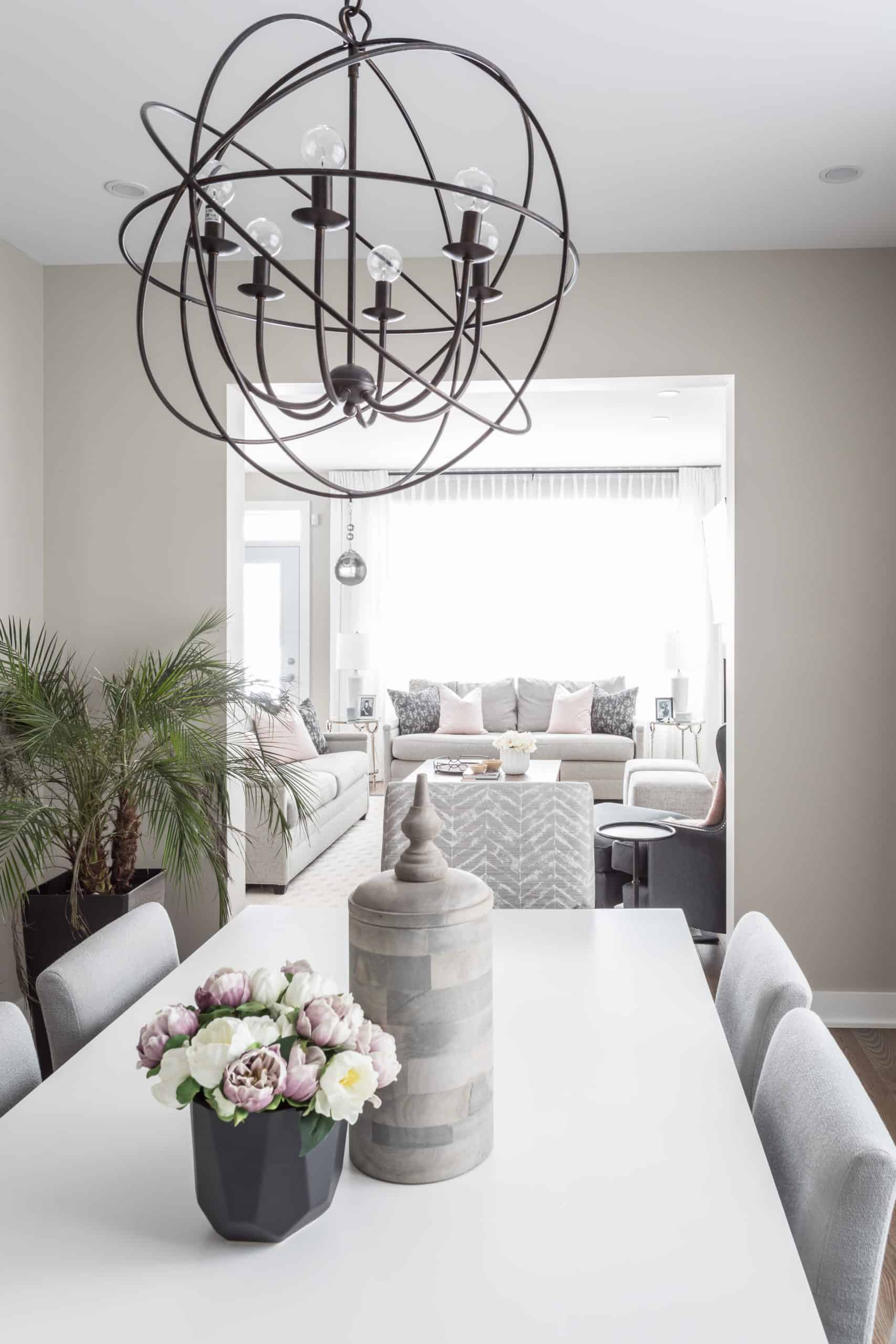 Small dinner table with a spherical chandelier above it