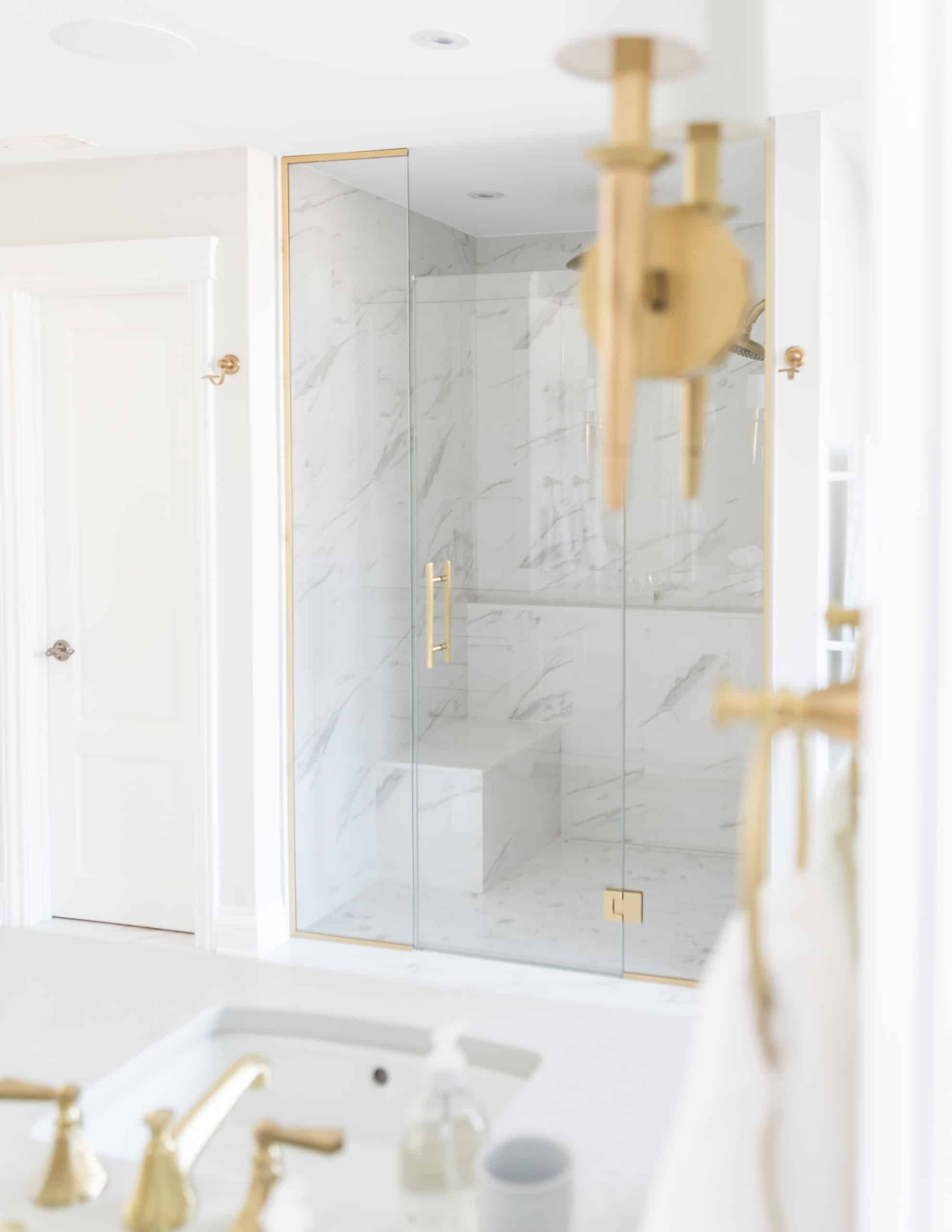 Modern walk in shower with marble everywhere inside it