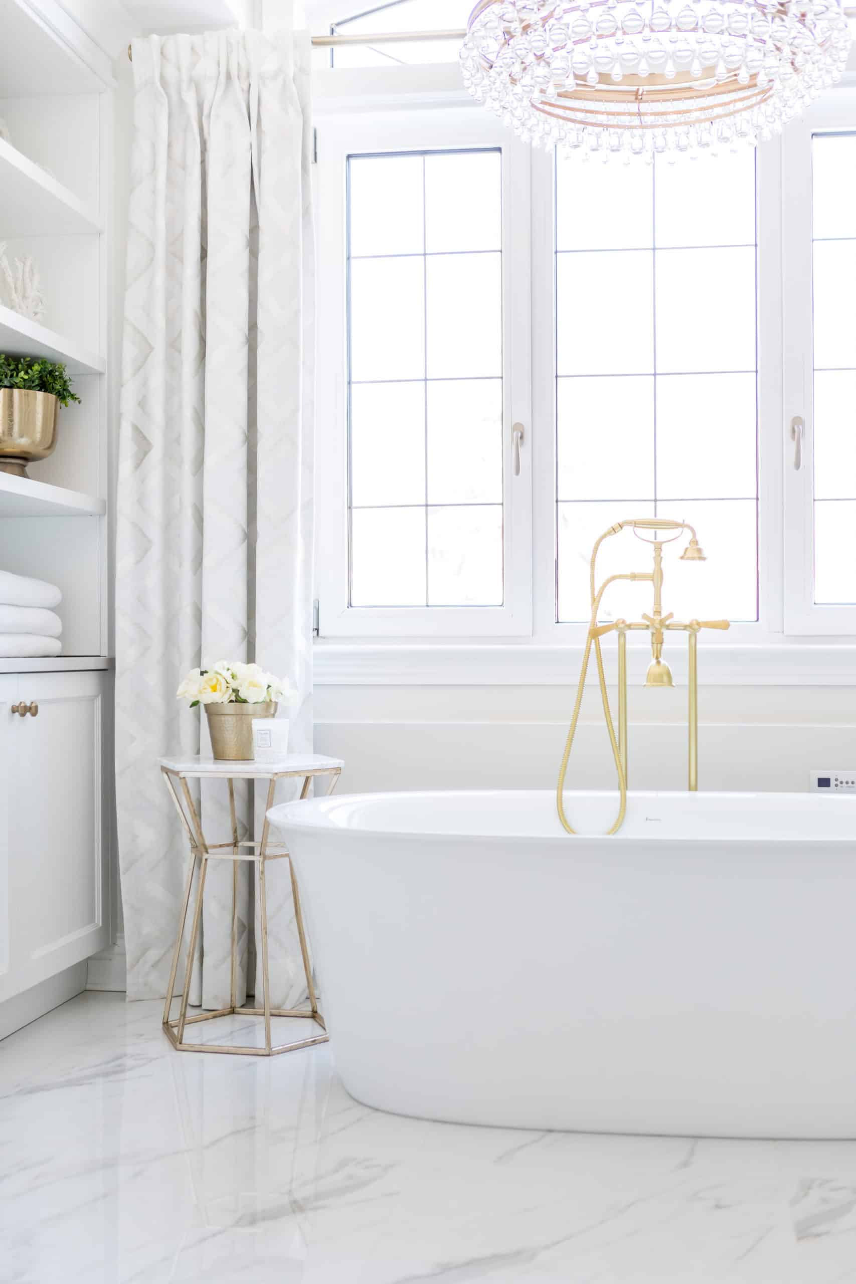 White soaker tub with a golden faucet