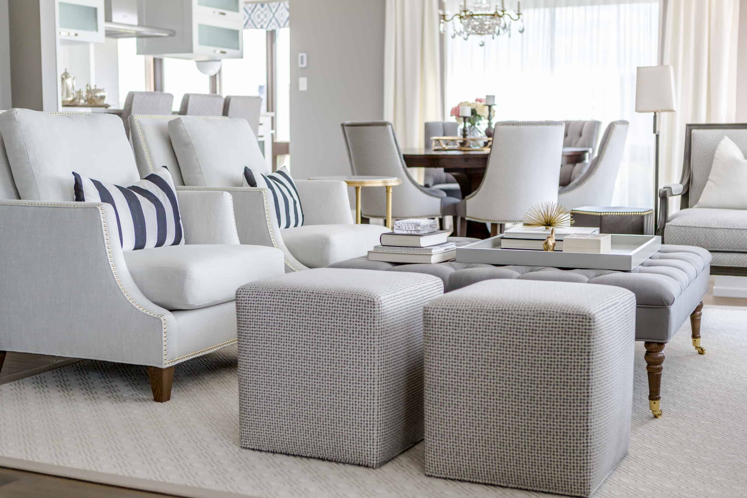 Modern living room with a focus on two small gray stools next to the coffee table