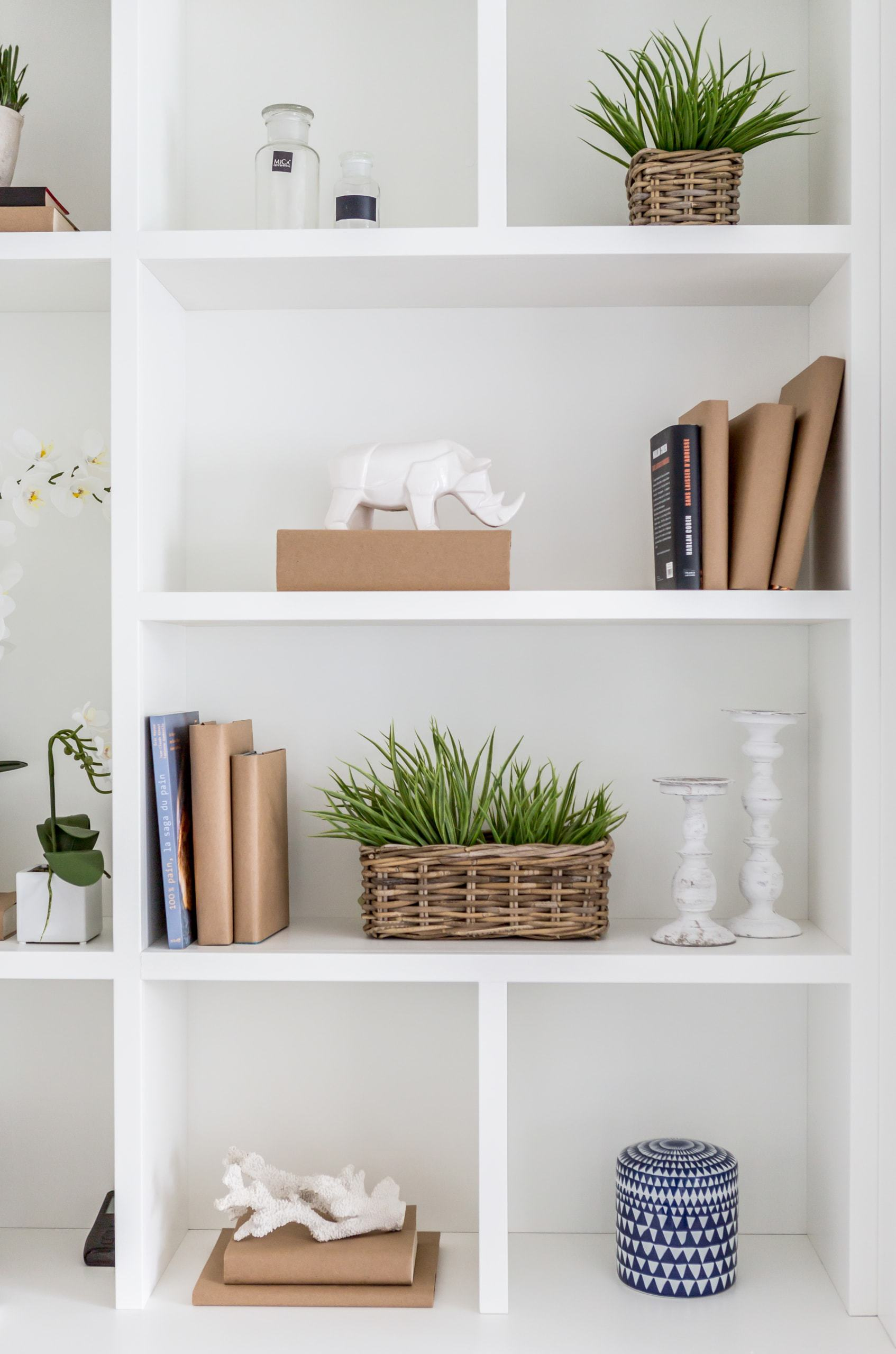 Various decorations on a white shelving unit