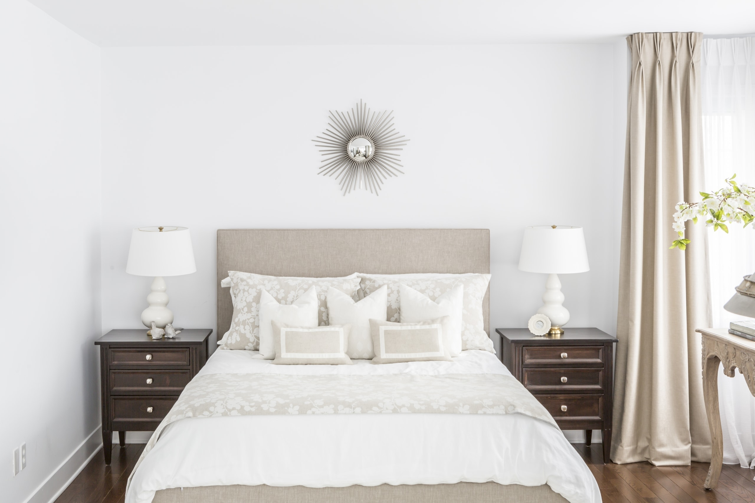 Bright master bedroom with a bright white bed
