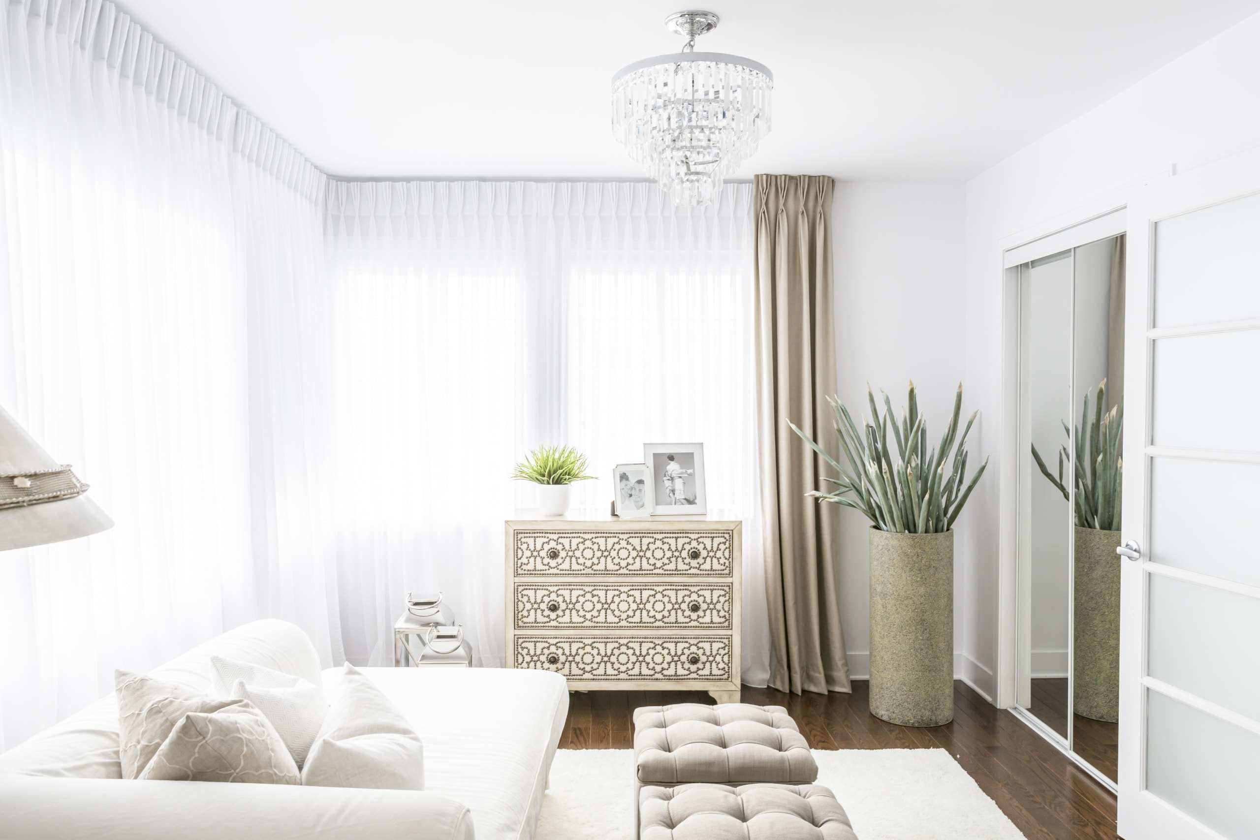 Bright master bedroom with blinds covering very bright windows