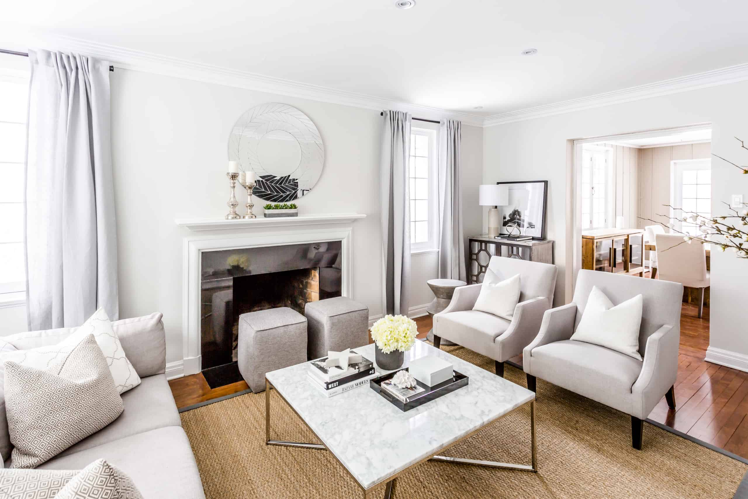 Large, open living room with a large, marble coffee table