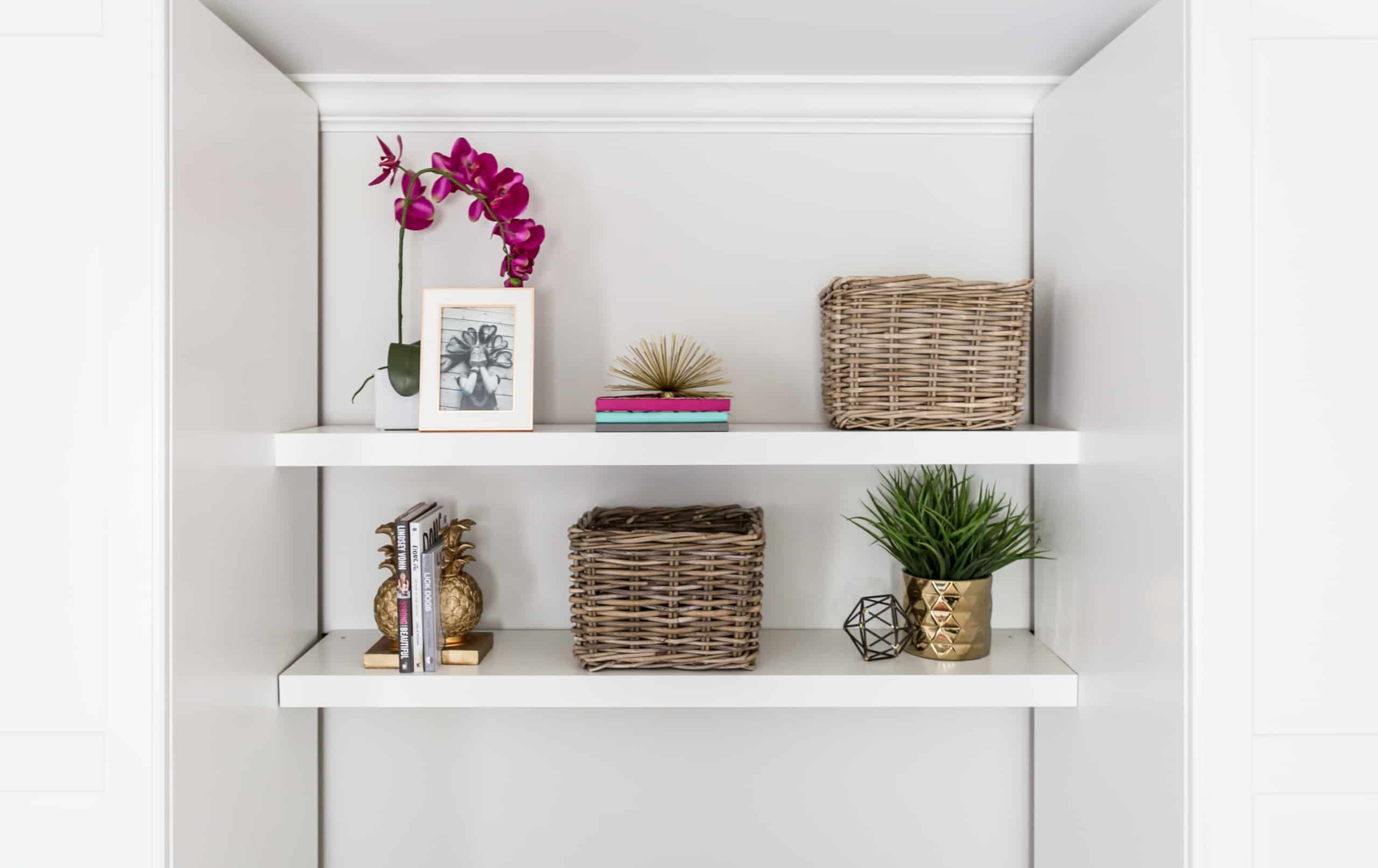 Bookshelf with various decorations on it
