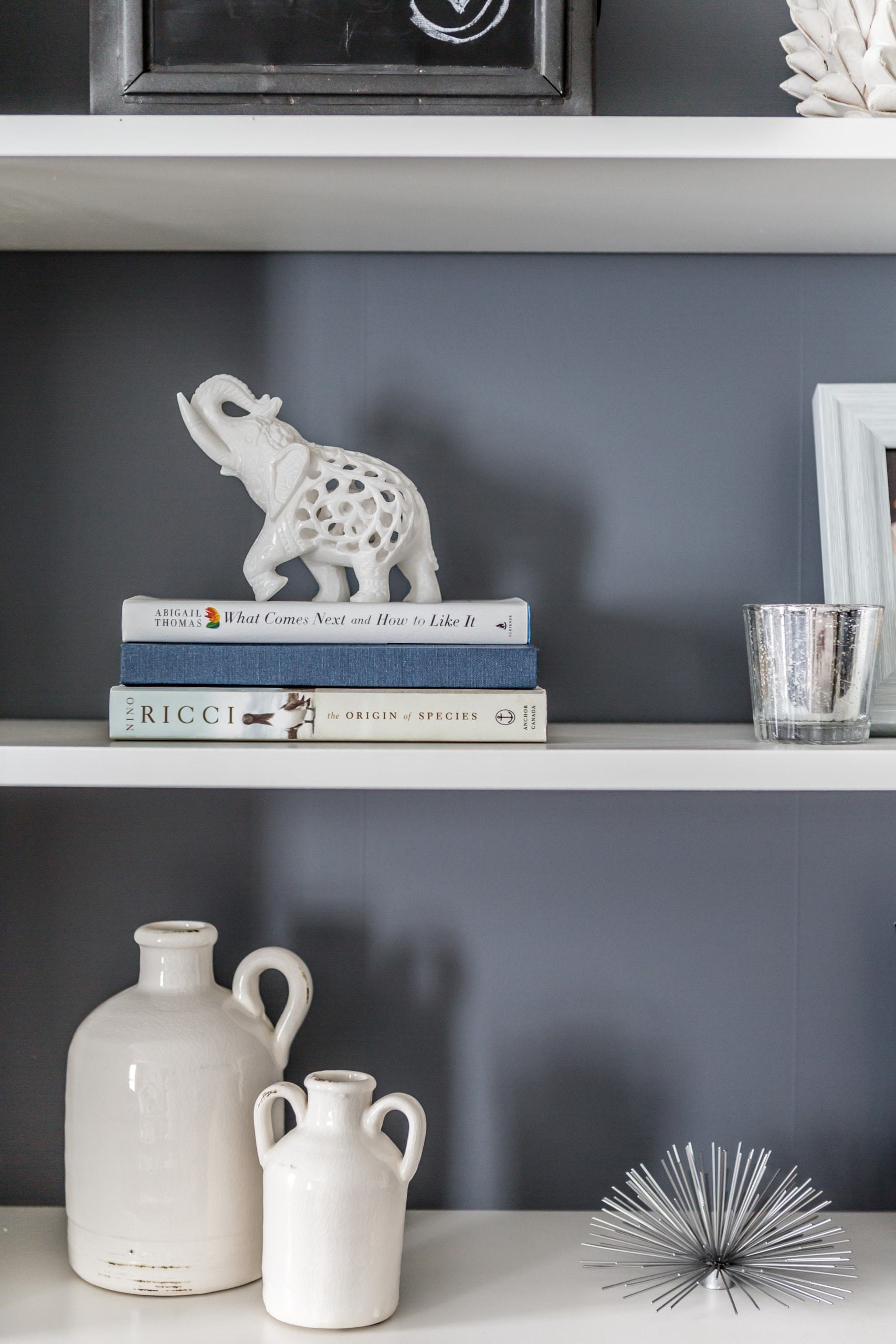 Bookcase with a variety of decoration on it