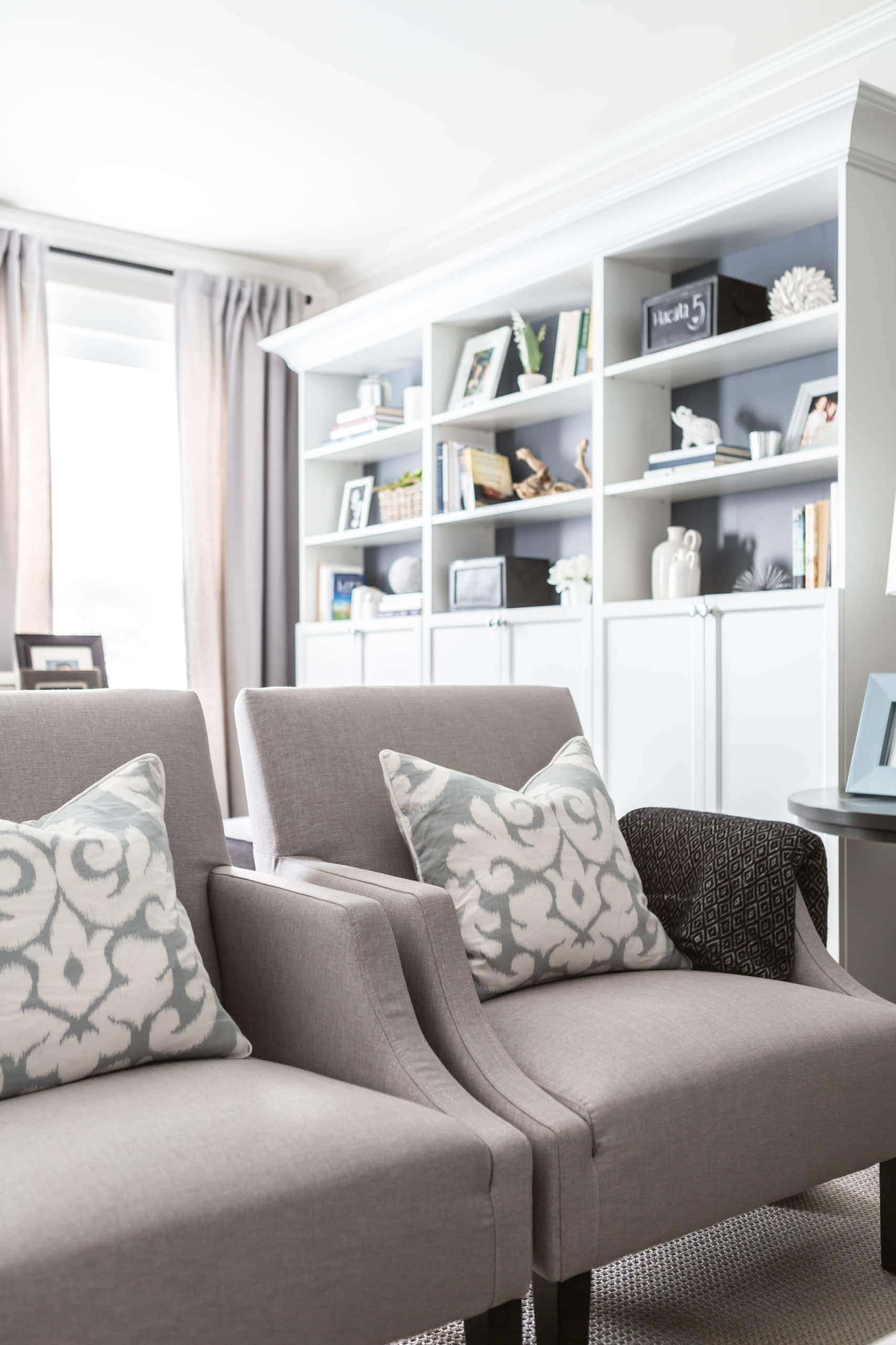 Two gray chairs inside a living room