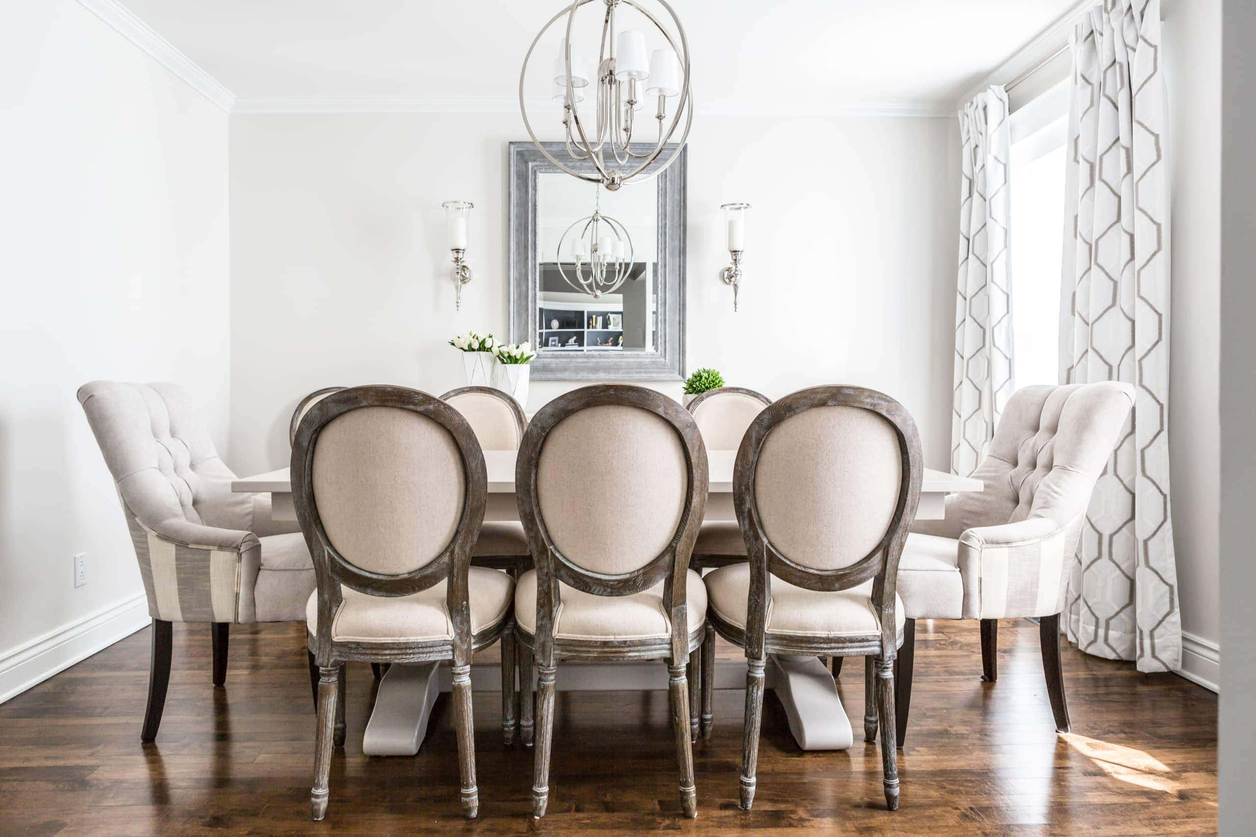 Bright, white dining room with a focus on the table
