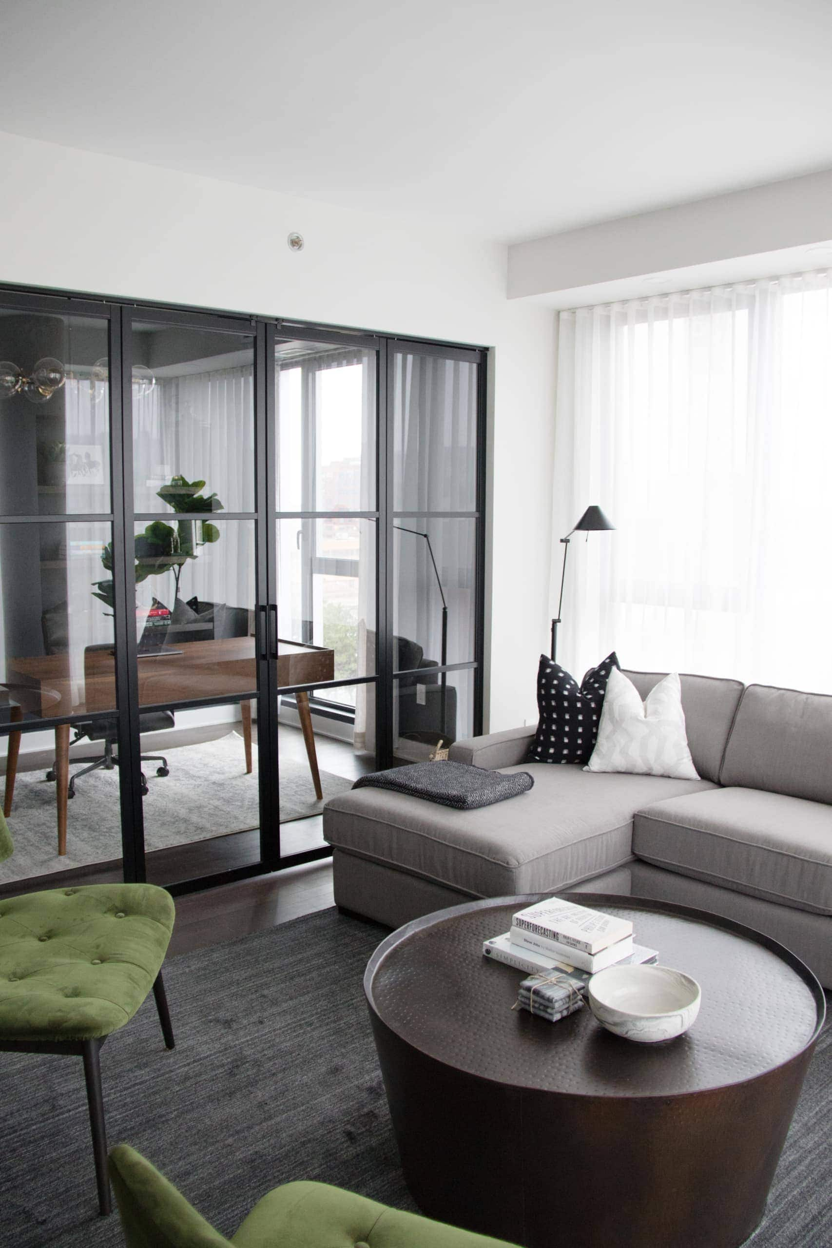 Modern living room with two green chair in the corners