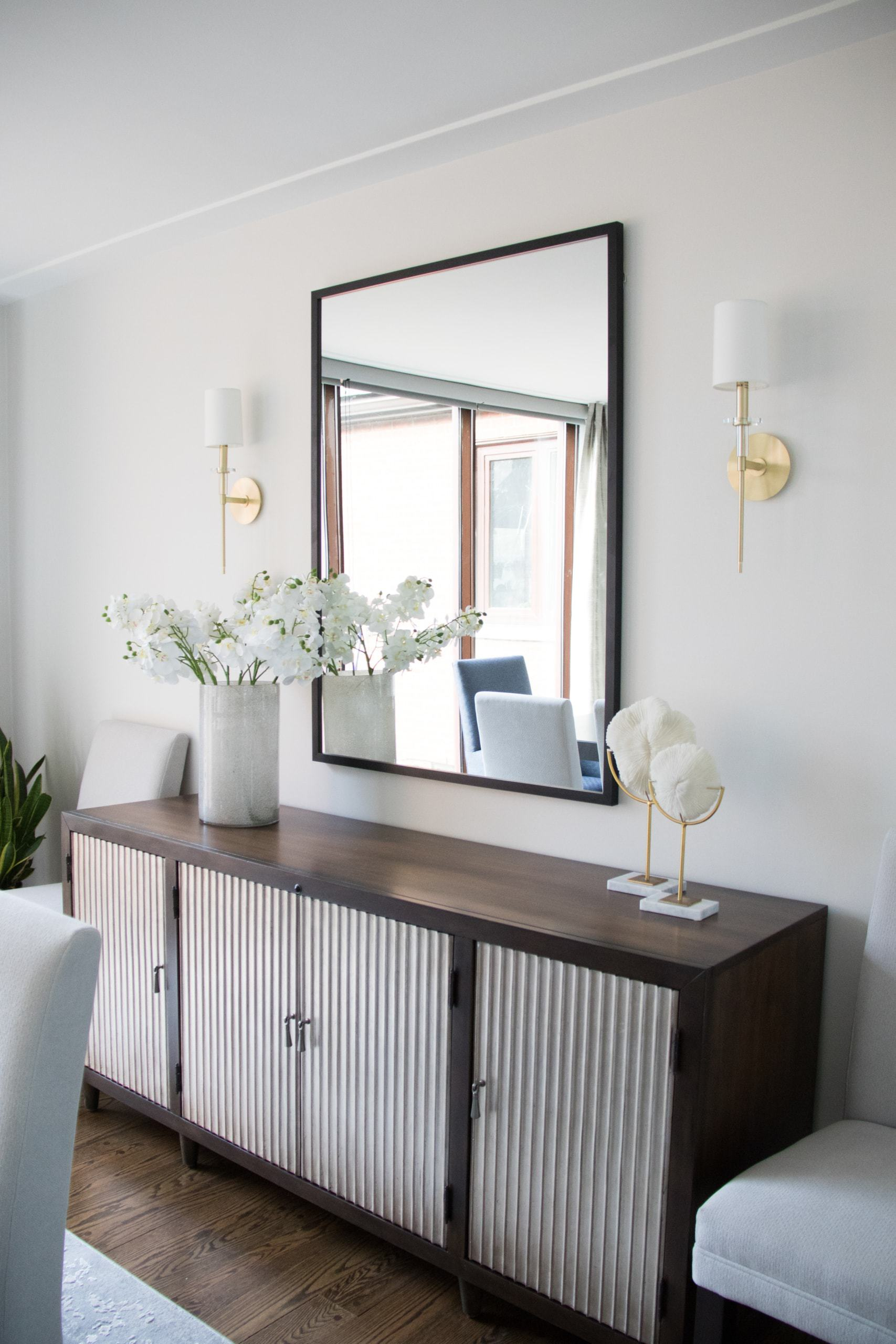 Large mirror above cabinets inside the dining room