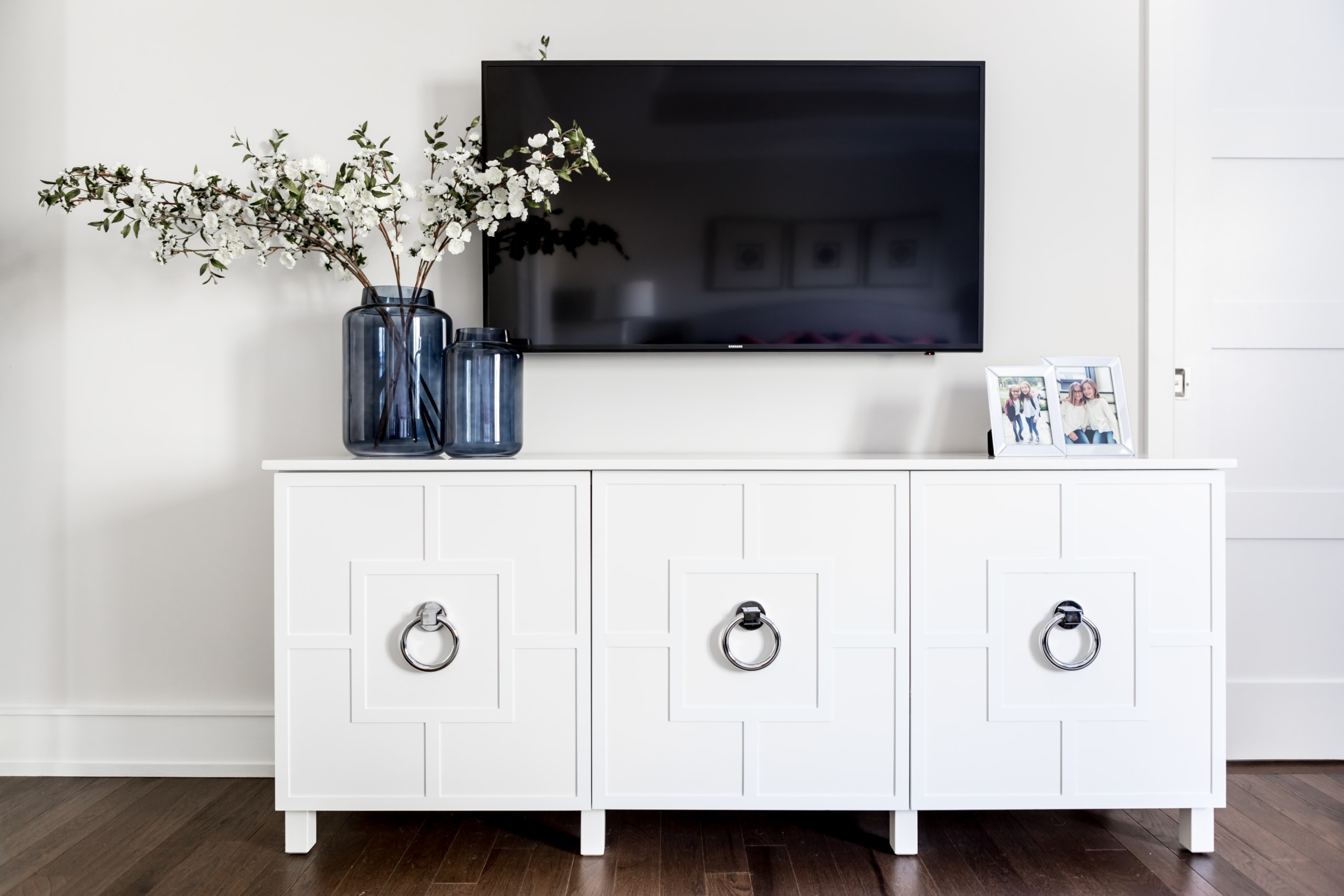 White cupboards under the television