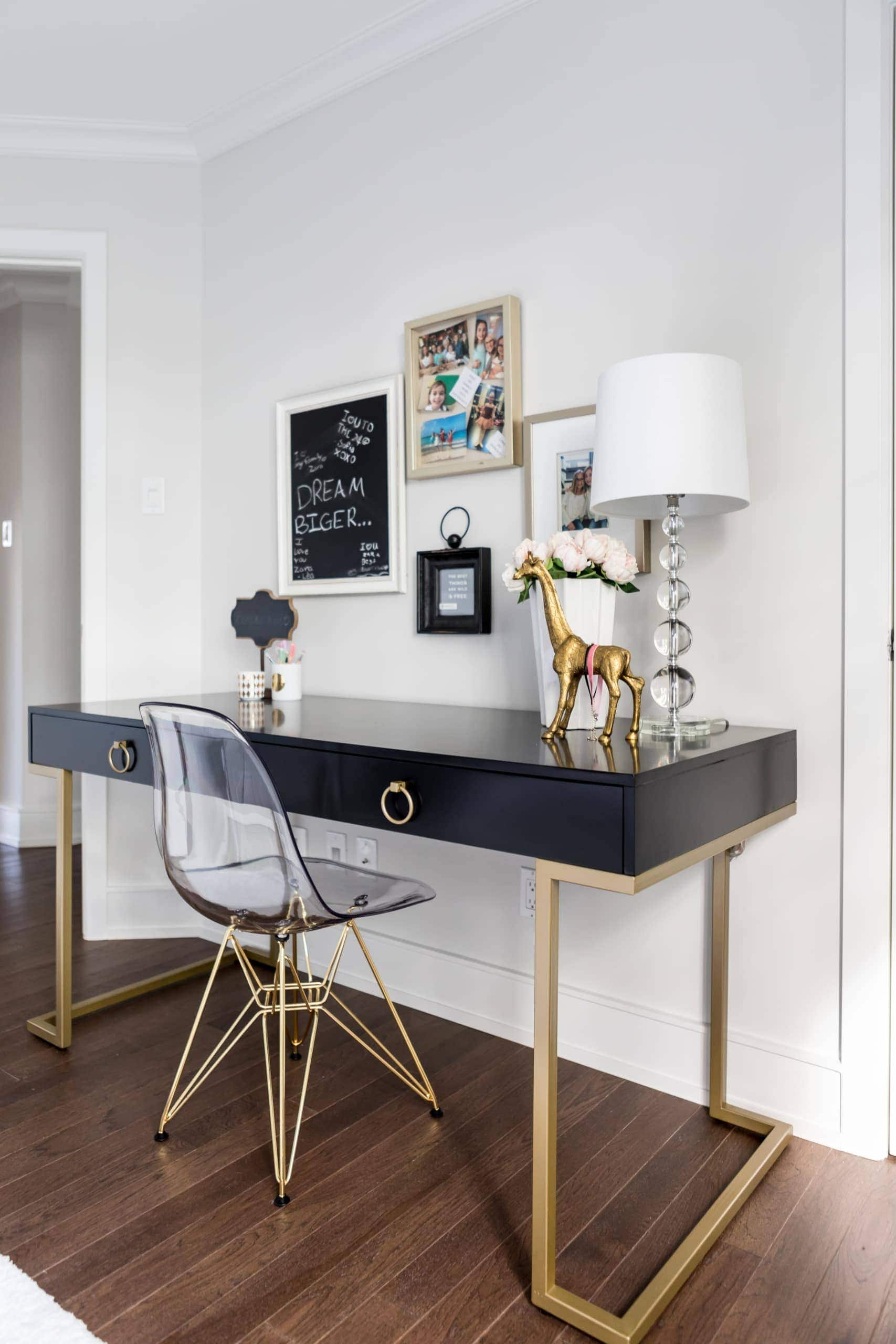 Glass chair inside a black and gold themed office