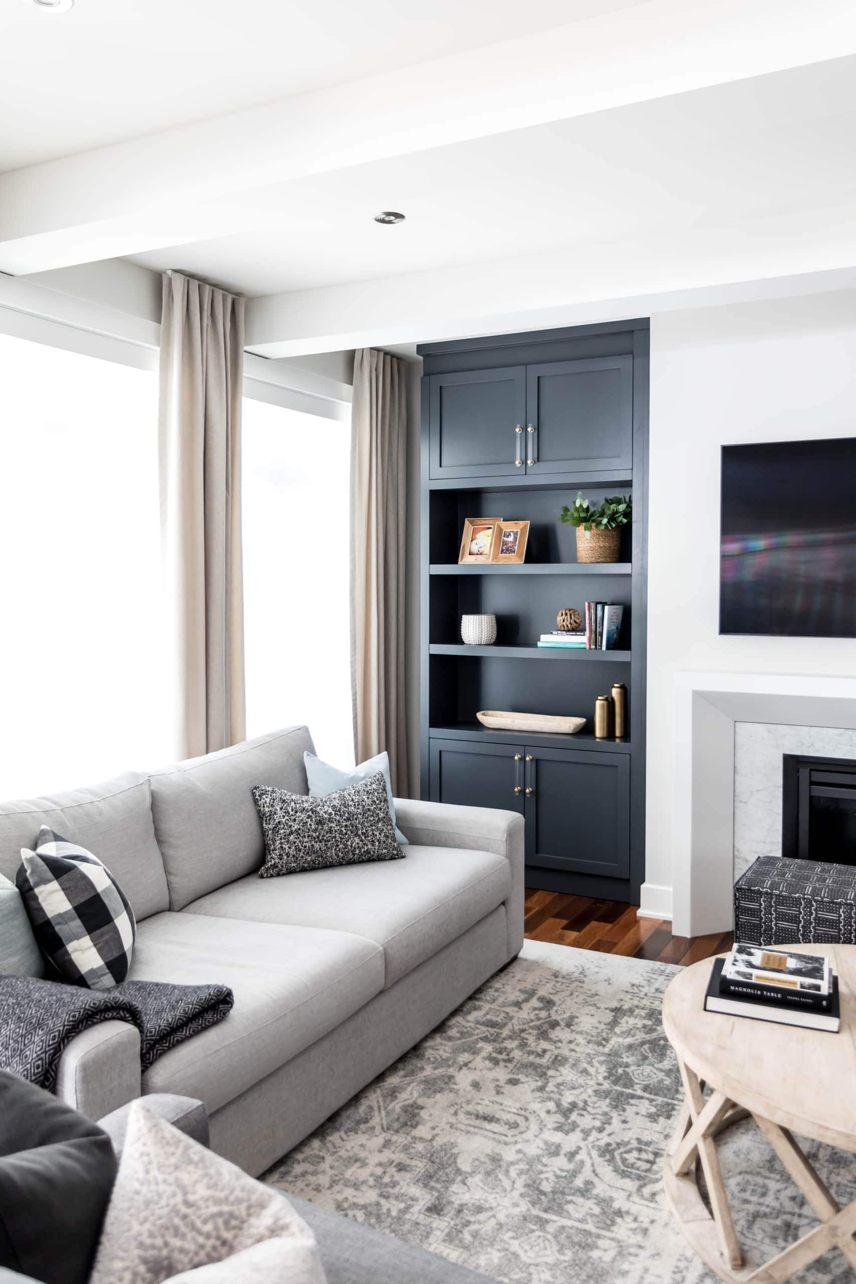 Blue bookcase next to fireplace inside living room
