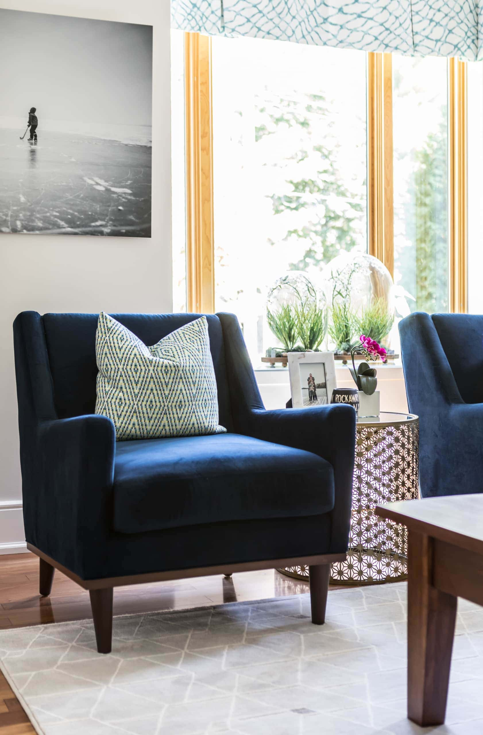 Blue chairs against a large window