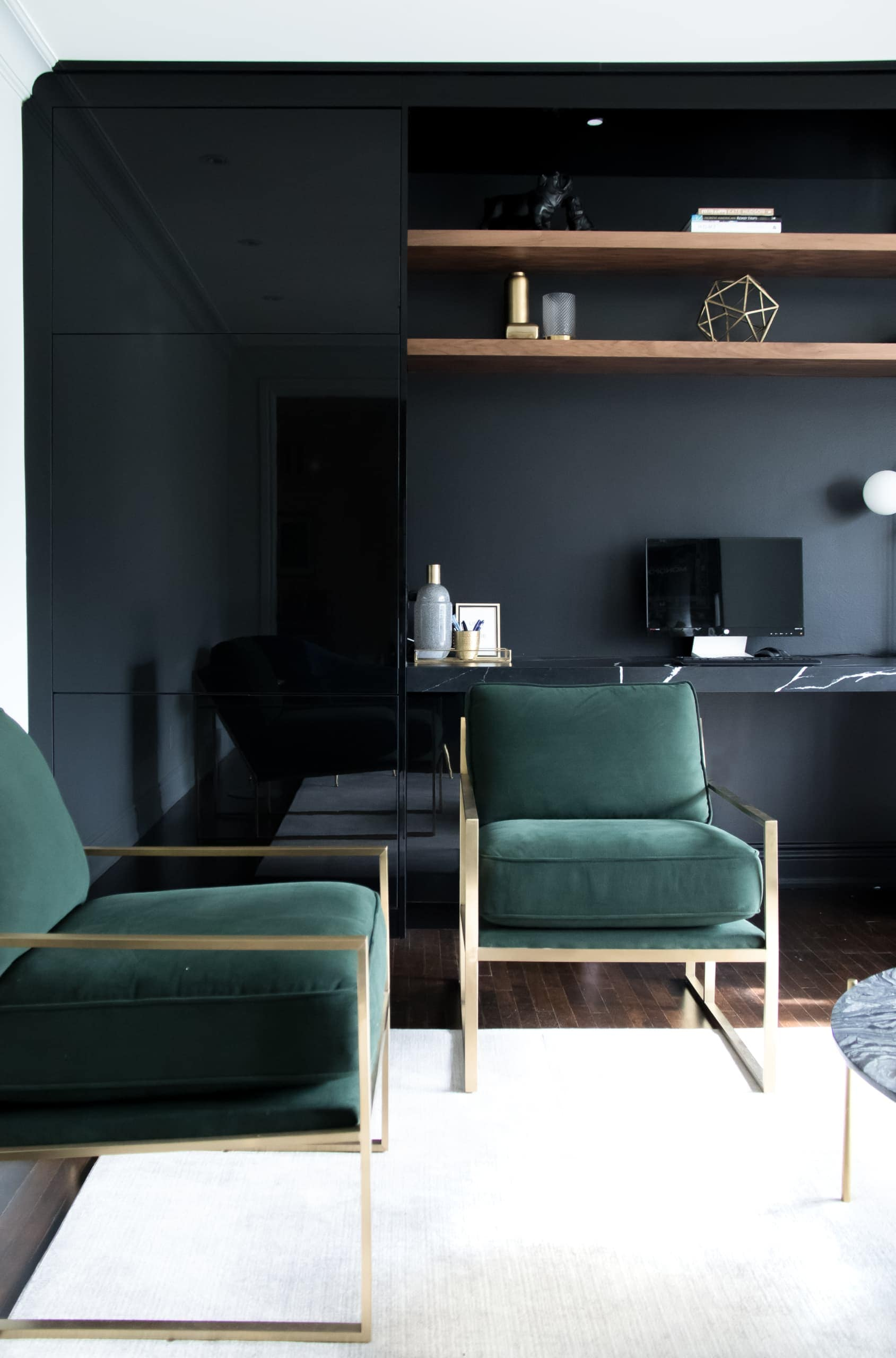Green chairs next to a dark wall