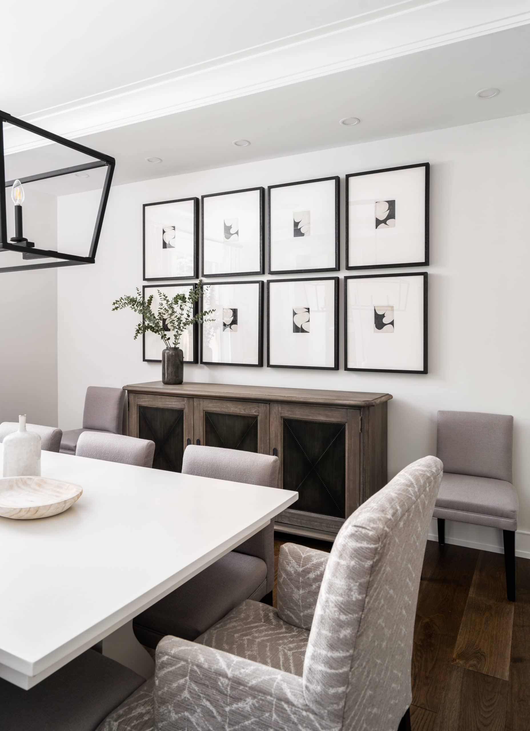 Modern, clean dining room with a white table