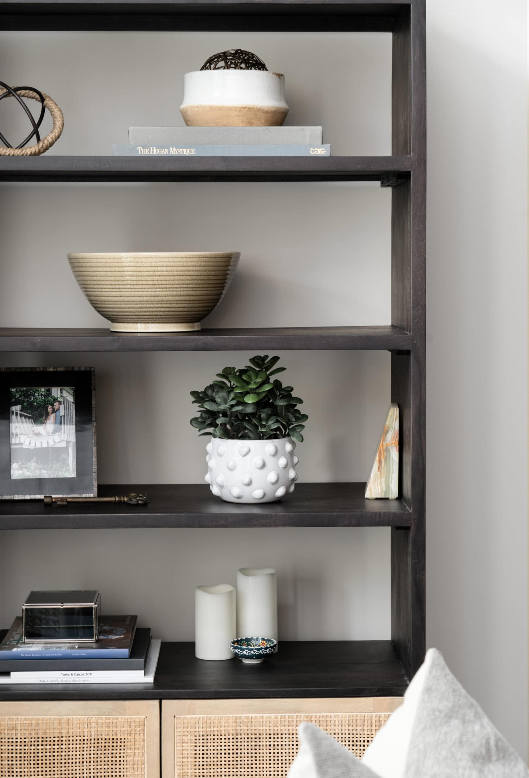 Dark shelving unit with an assortment of decorations