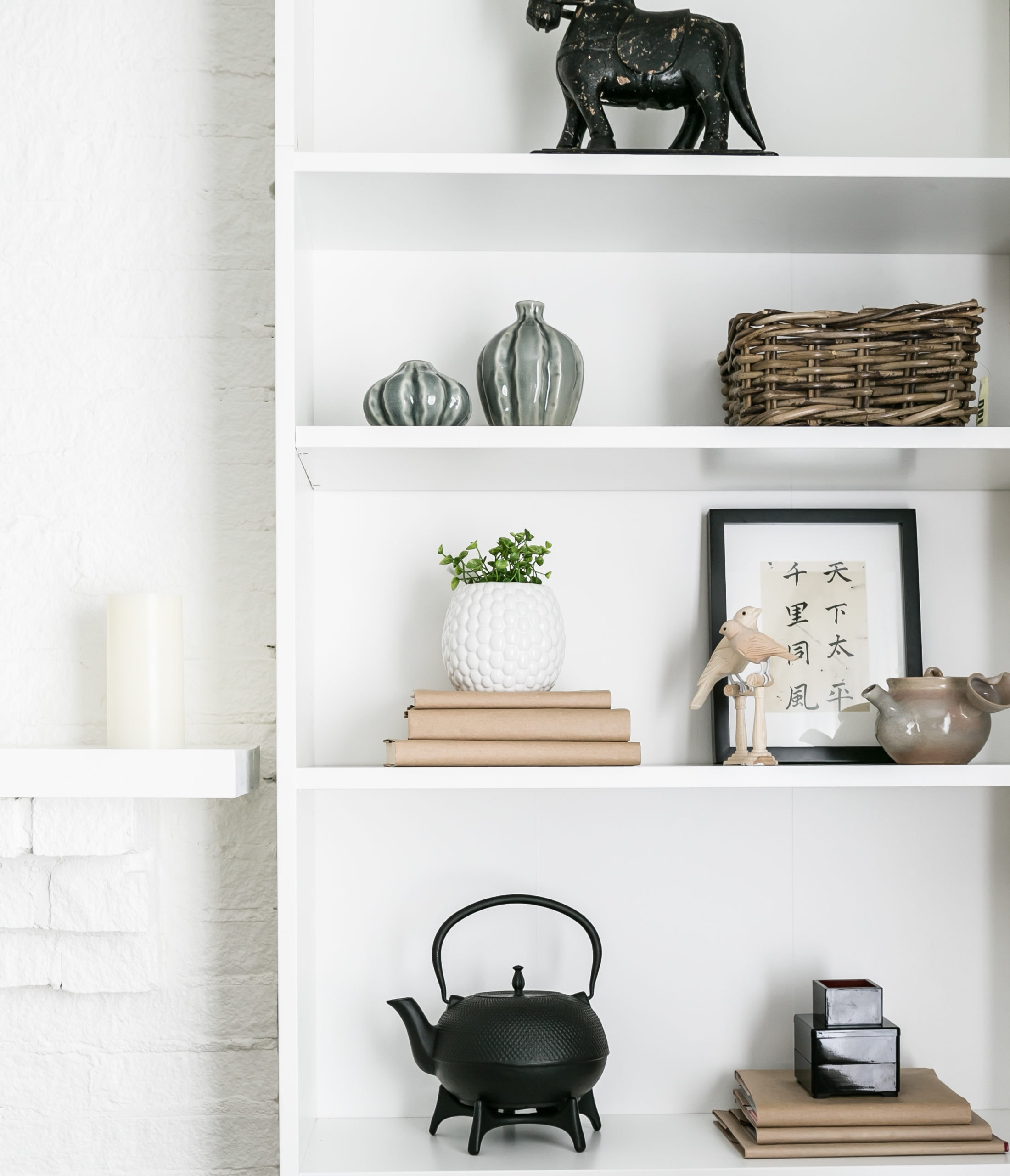 Bright shelving unit with an assortment decorations on it