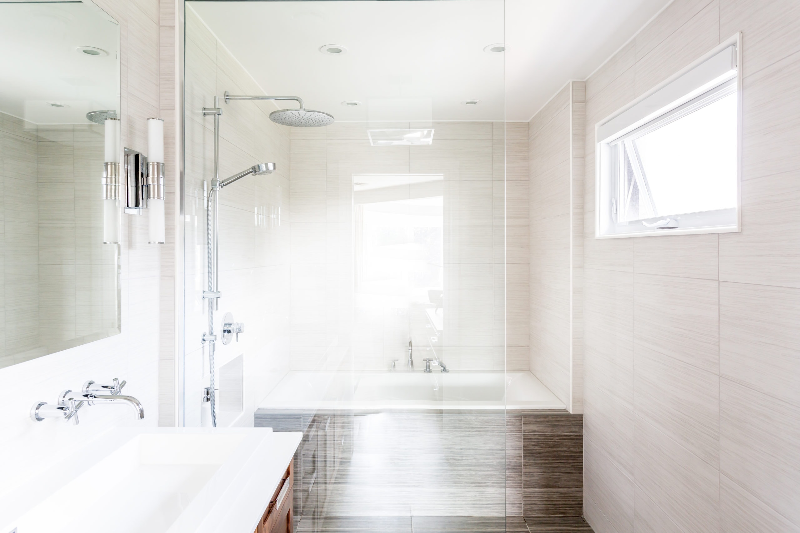 Bright clean bathroom with a focus on the separate shower and bathtub