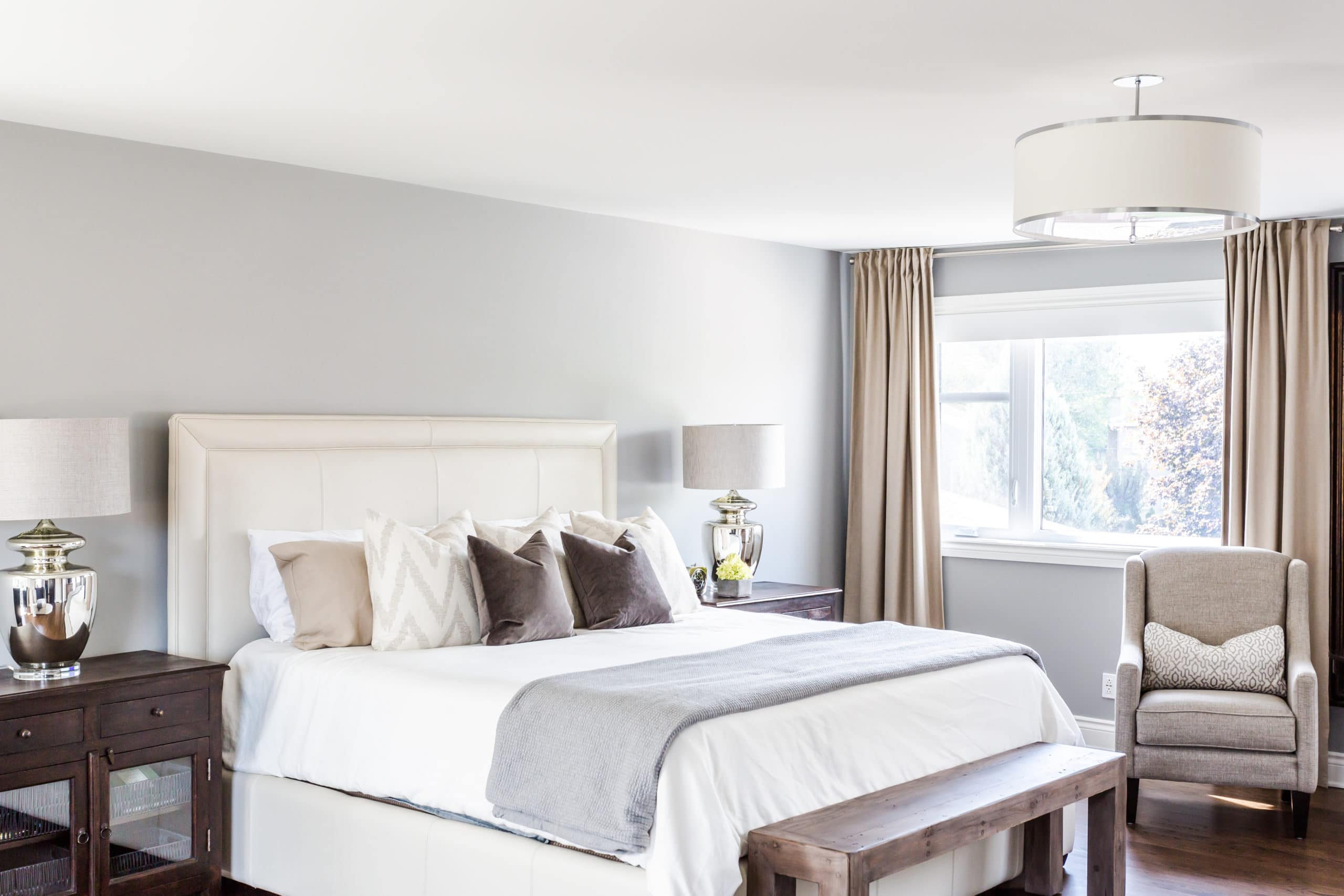 Modern master bedroom containing a large white bed
