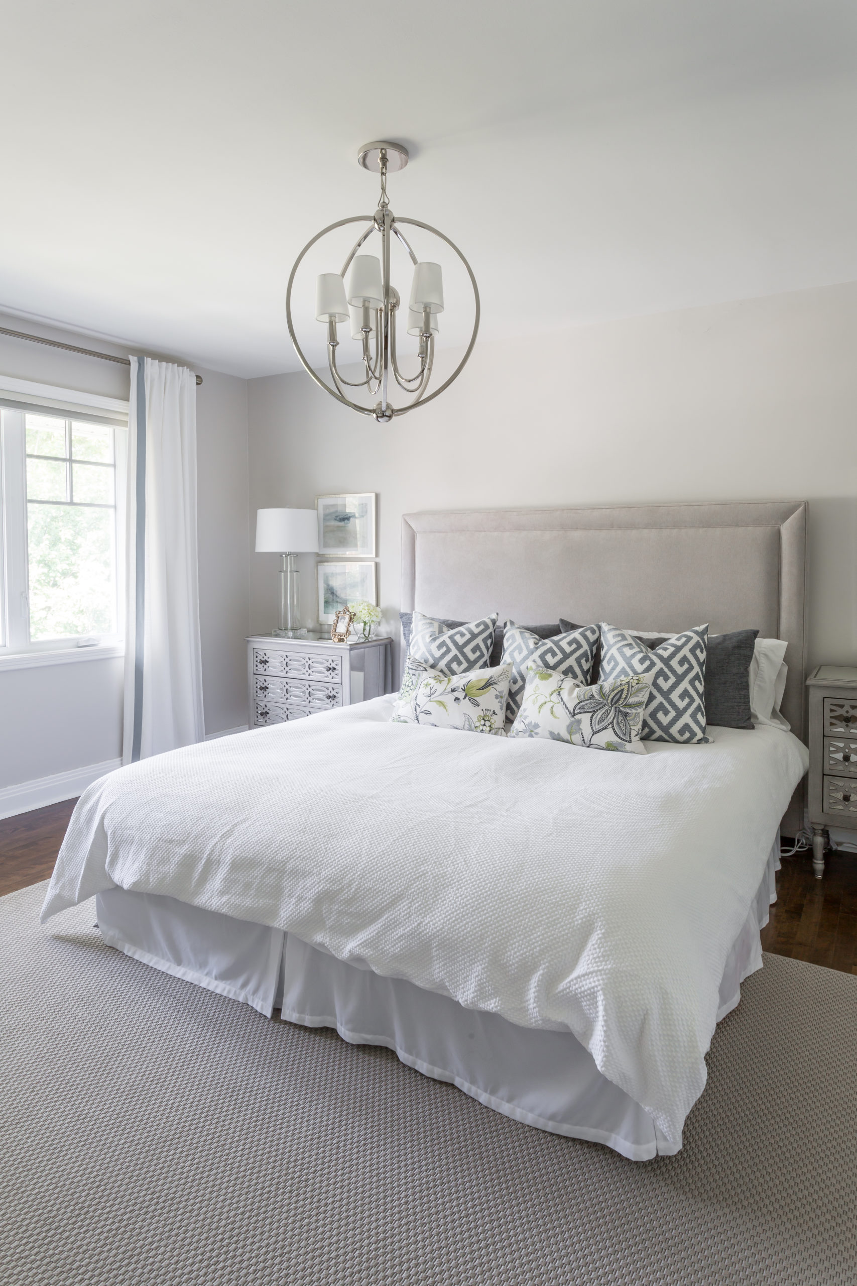 Large, white bed within a master bedroom