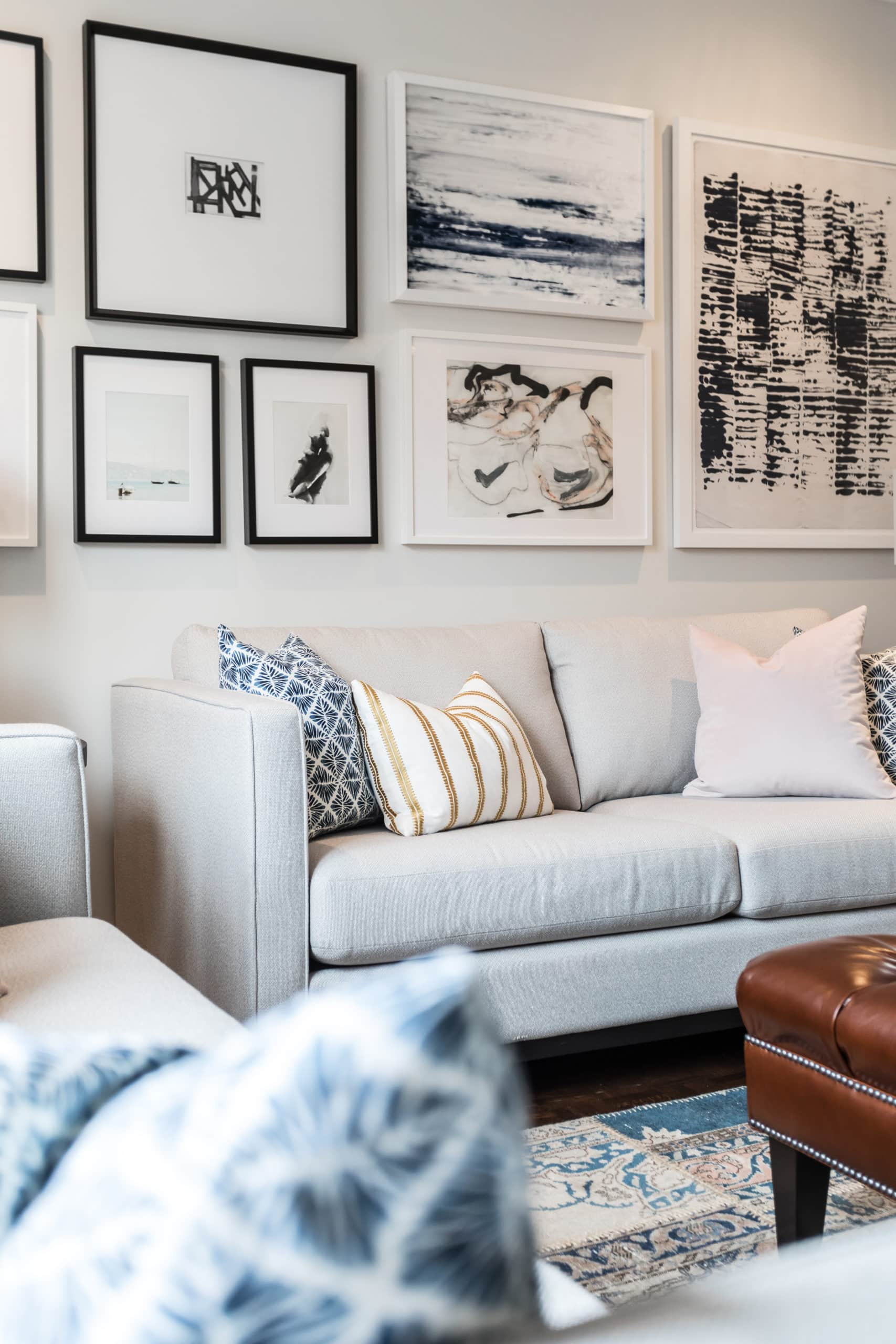 Cozy living room with lots of pictures on wall