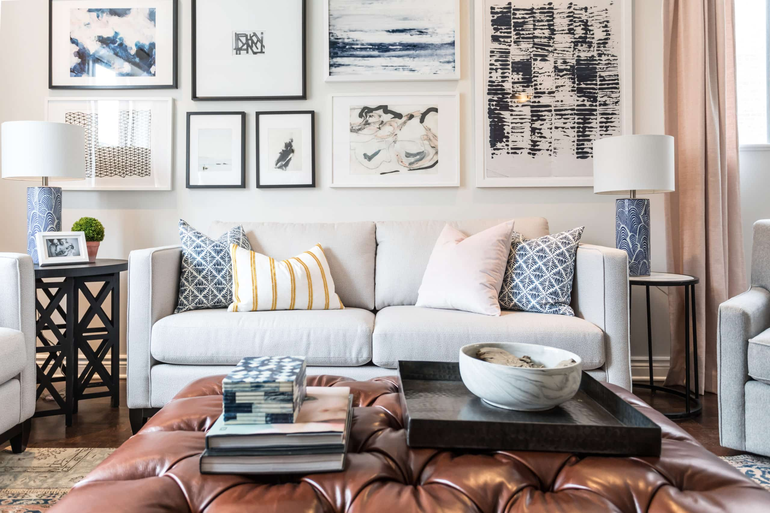 Gray sofa with lots of pictures above it