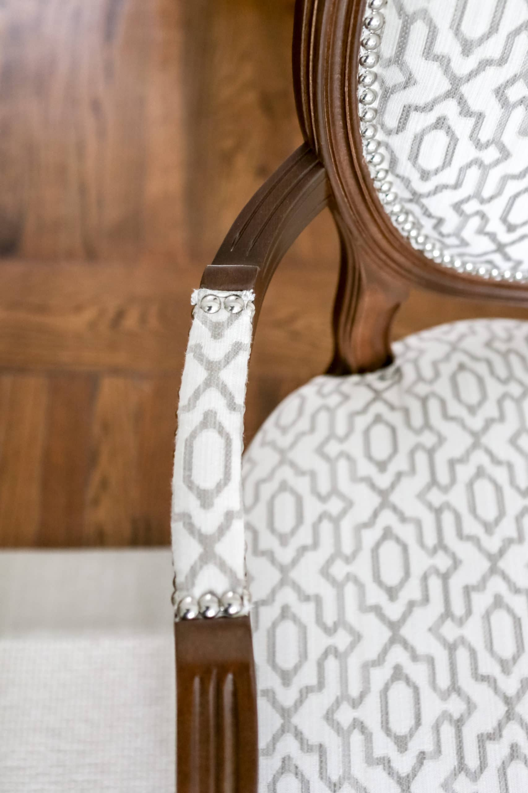 The armrest of a small fancy chair