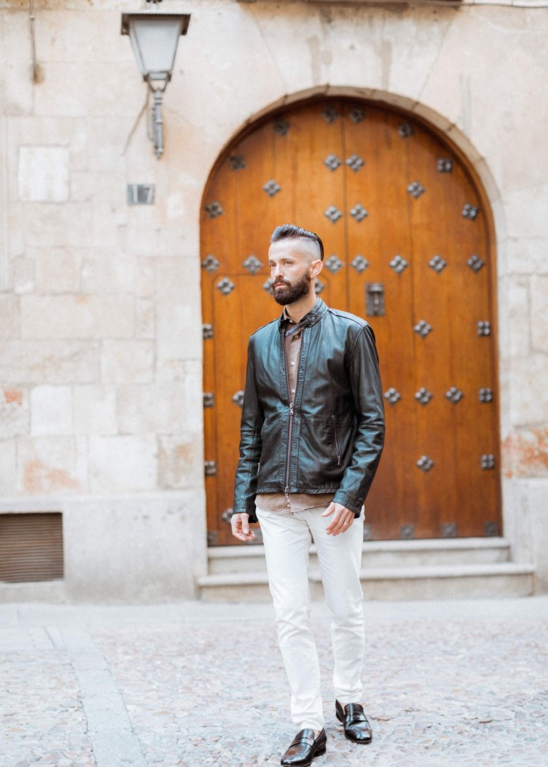 Michael Checkers men's street style blogger wearing a black leather jacket in Spain in the Fall